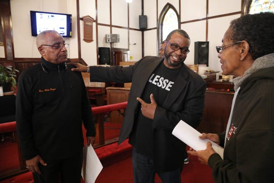 Rev. Allen Boyer of the First Bethel AME Church and his son Rev. Dr. Charles Boyer talk before the event began with Diane Colson  of the New Jersey Black Issues Convention on February 16, 2019.The New Jersey Institute for Social Justice and other social justice advocacy groups came together at the First Bethel AME Church to conduct the 94 Percent follow up meeting. Governor Phil Murphy received 94% of the African American vote and the meeting discusses legislation that would help the African American community.