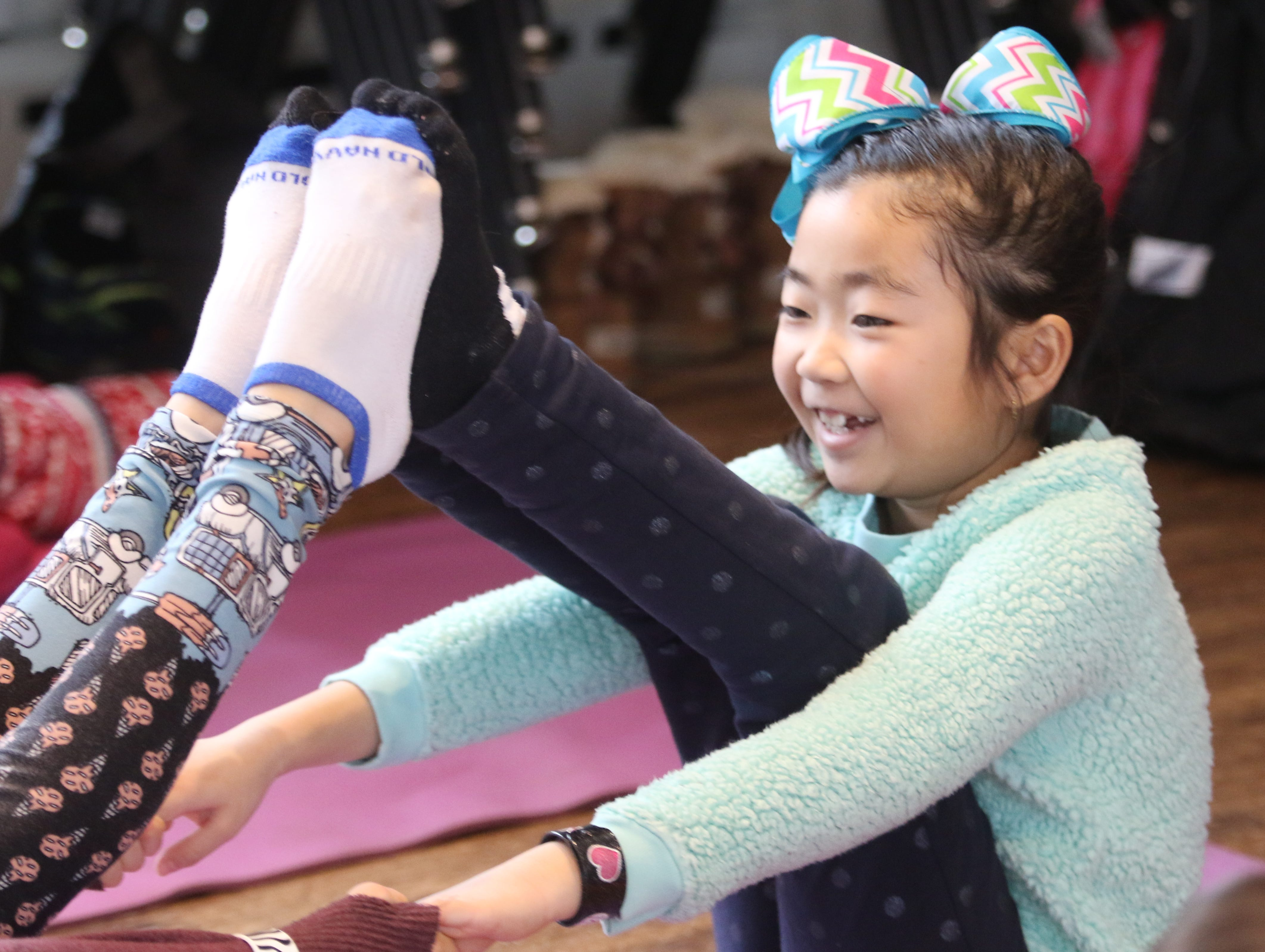 "Everleigh Ng 8 participates in a yoga class that is part of Winterfest on February 15, 2019. Ridgewood Parks and Recreation, in partnership with HealthBarn USA, celebrated ""Winterfest"", a day for kids baking cookies, doing yoga and taking a nature walk."