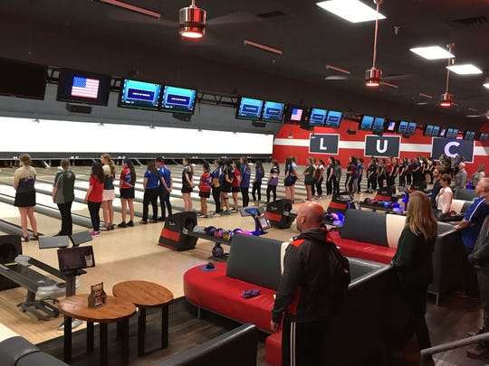 Girls competitors on the foul line for the national anthem at the NJSIAA individual bowling finals on Friday, Feb. 15, 2019 at Bowlero North Brunswick.