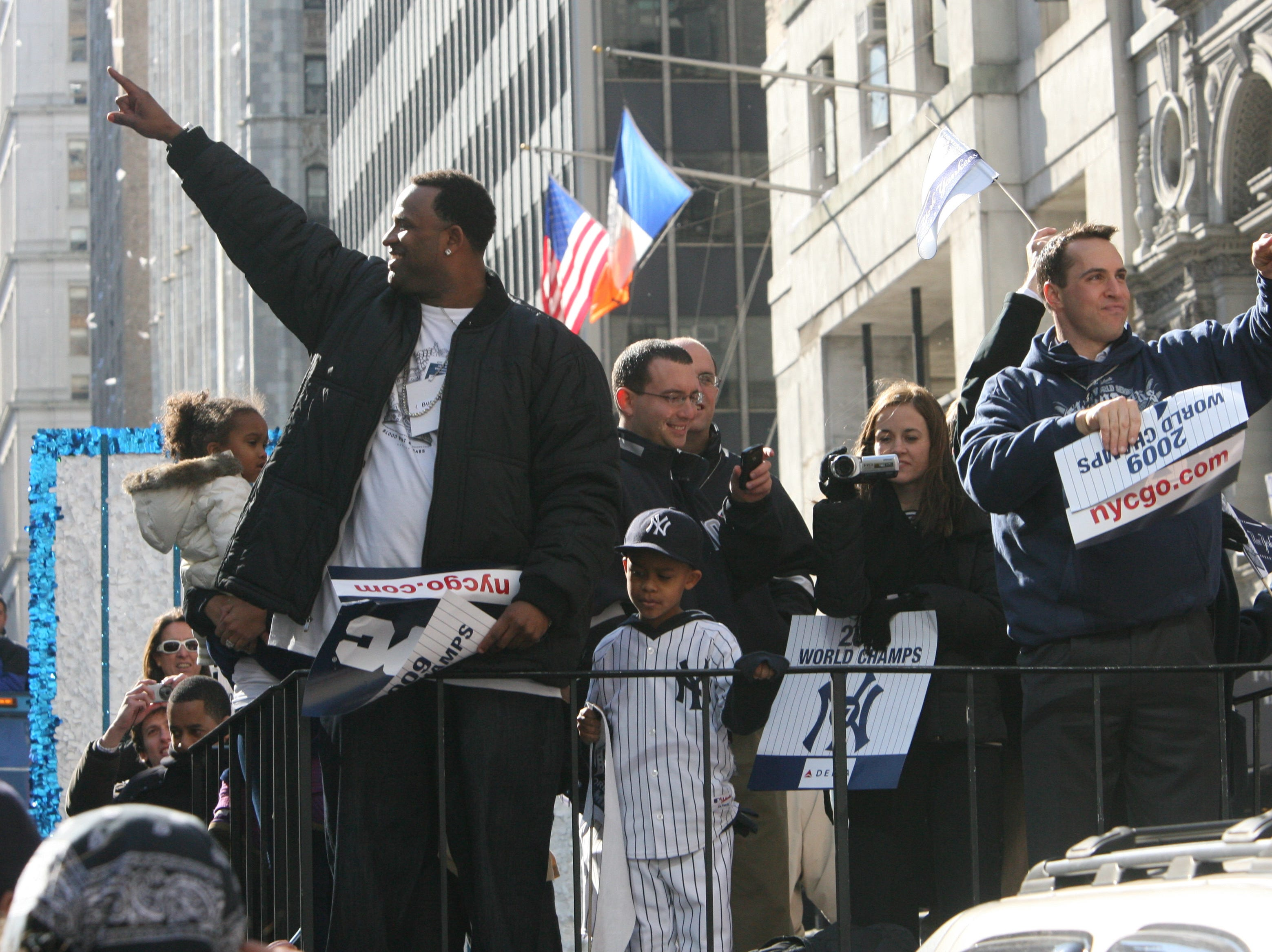 The Yankees make their way up Broadway to City Hall as the 2009 World Series Champions are honored with a parade.  CC Sabathia and Mark Teixeira making their way up Broadway on their float.