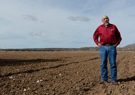 Andy Nuñez, mayor of Hatch, stands in a field on his farm where he grows cotton and chiles on Friday, Feb. 15, 2019. He is concerned about high turnover in the District 5 County Commission seat.