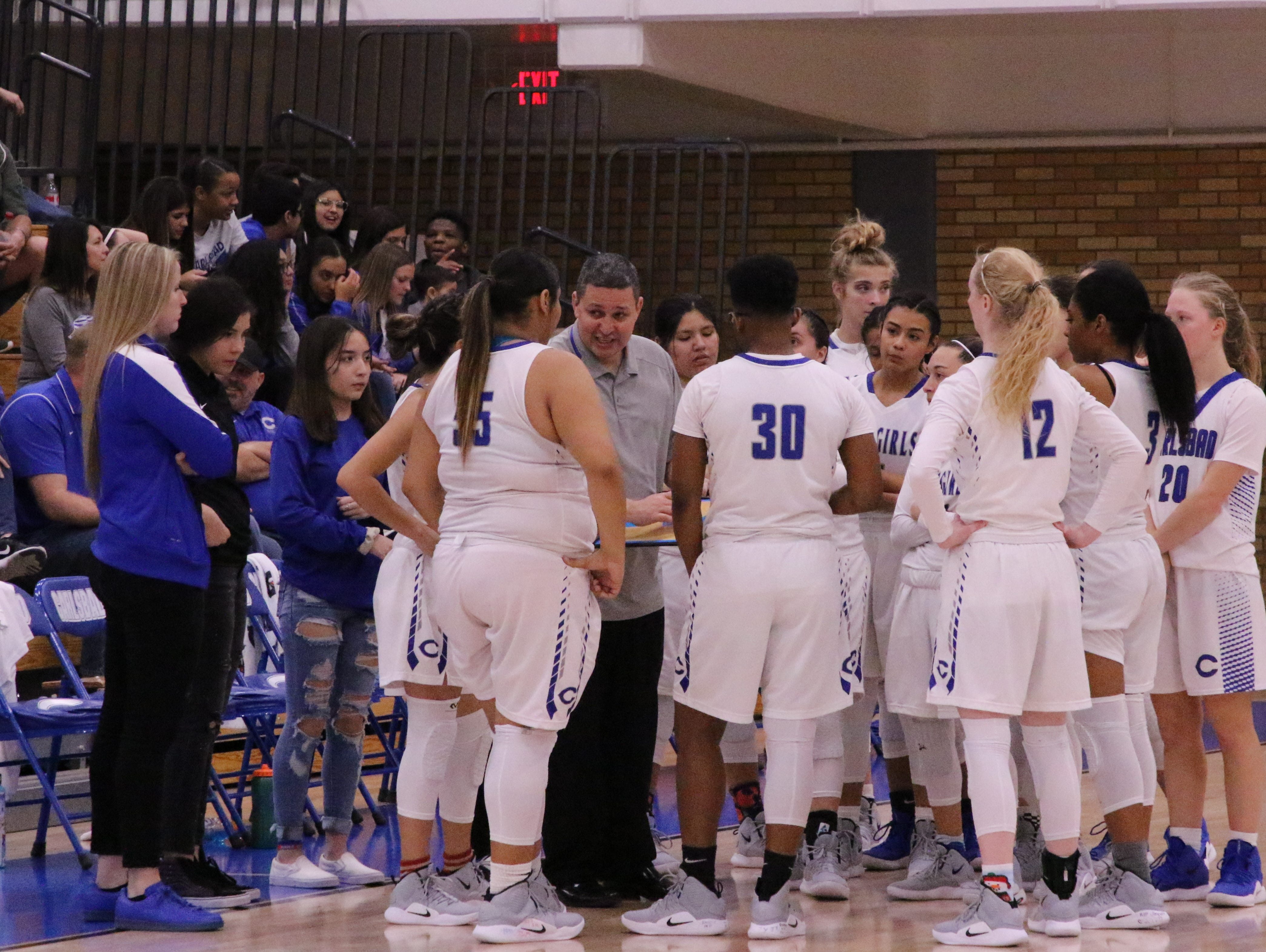 The Cavegirls talk during a timeout in Friday's game.