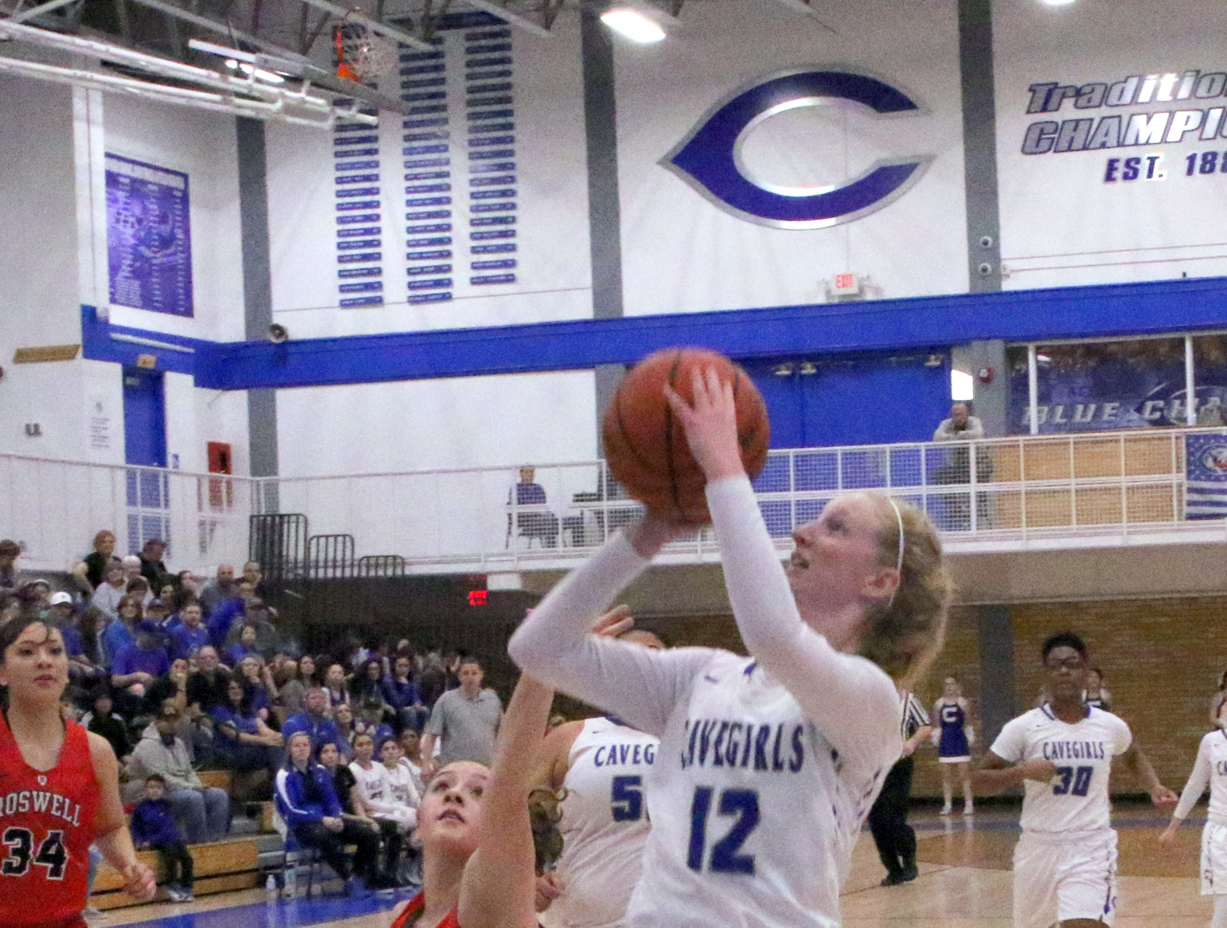 Carsyn Boswell gets a fastbreak shot during Friday's game.