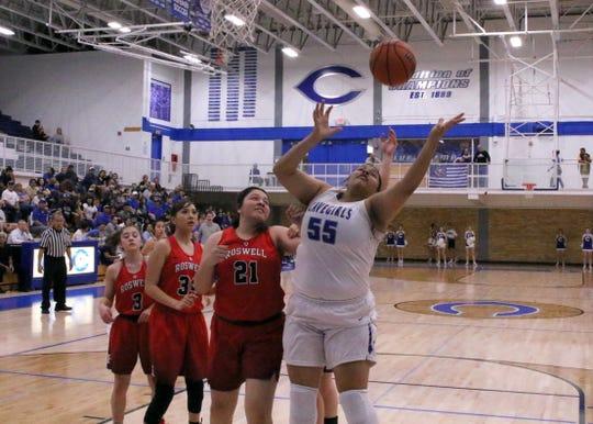 Kaliyah Montoya battles for a rebound during Friday's game.