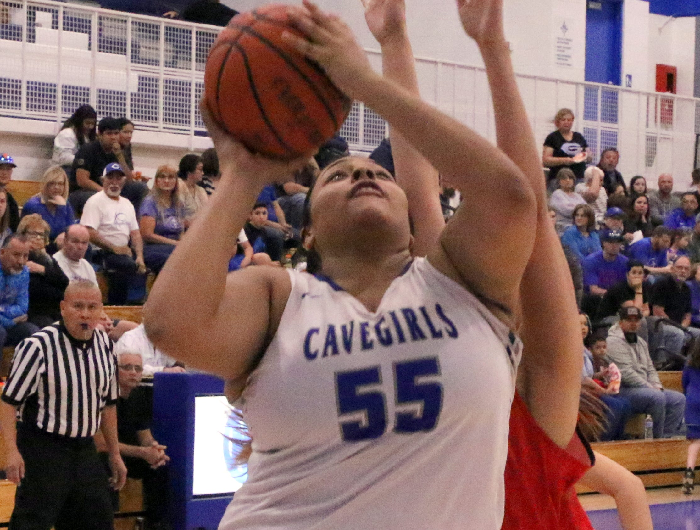 Kaliyah Montoya takes a contested shot during Friday's game.
