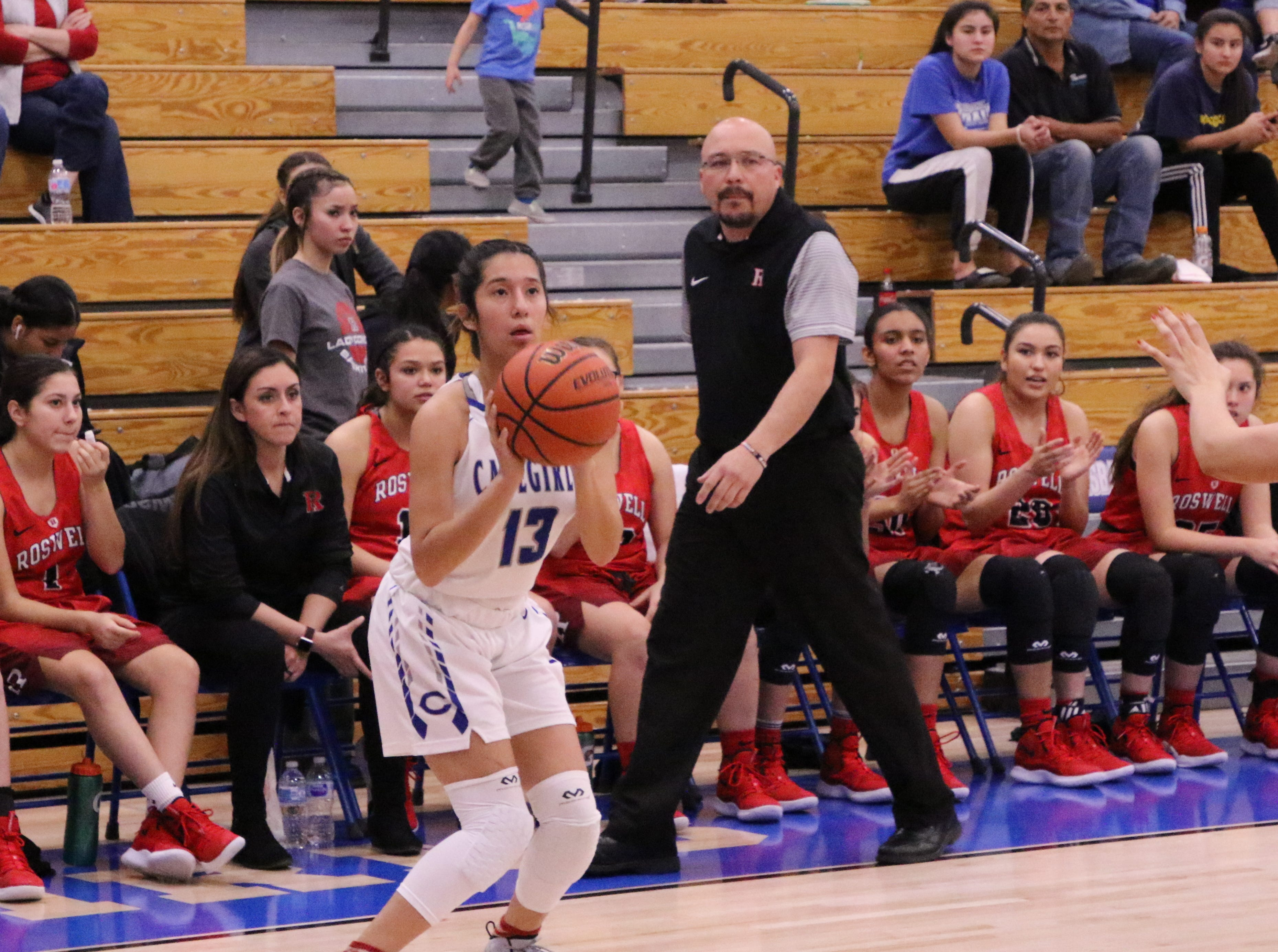 Tori Flores loads up for a 3-pointer during Friday's game.