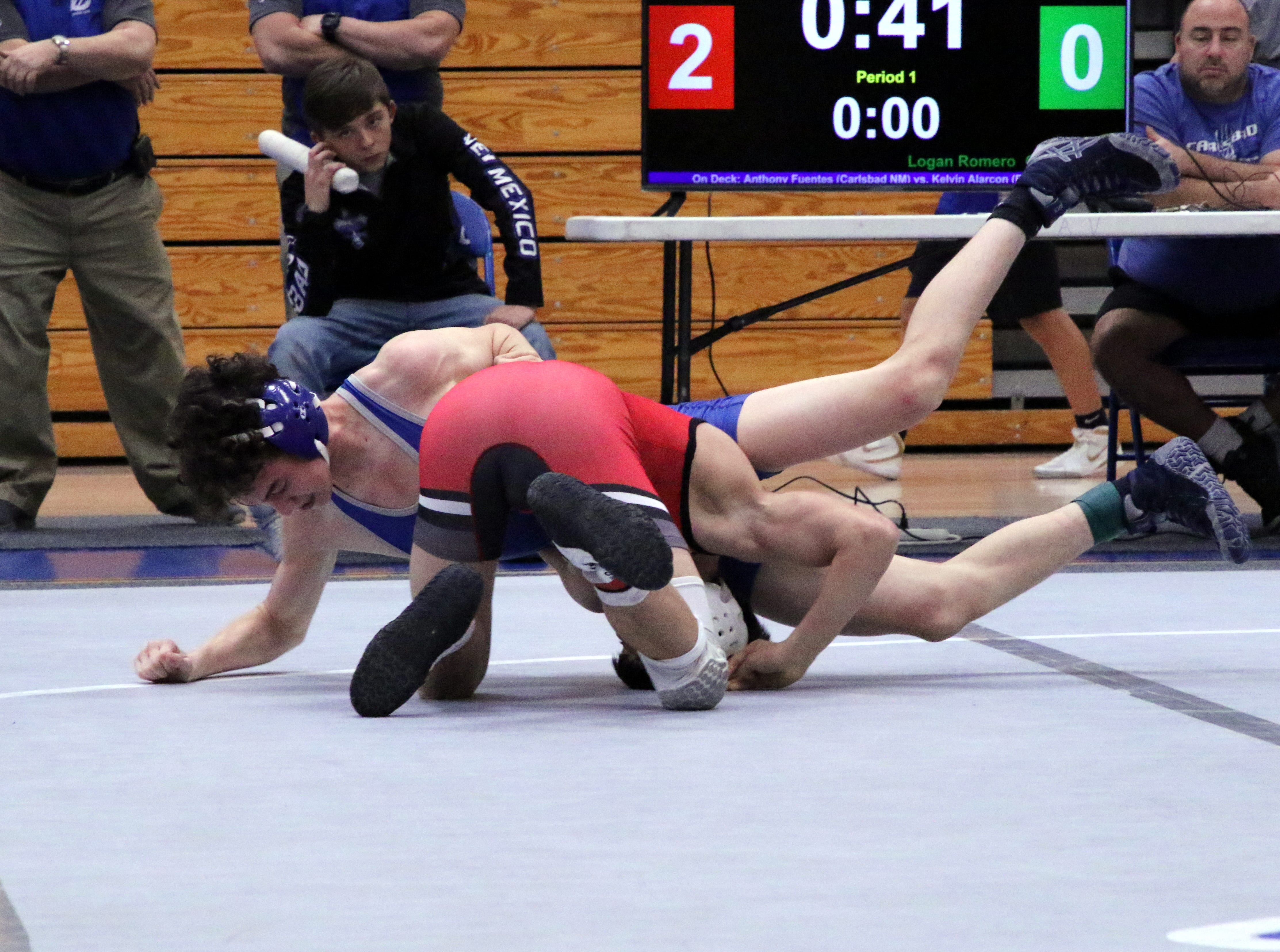 Logan Romero takes down Roswell's Jaymah Cherinko in the 113-pound division.
