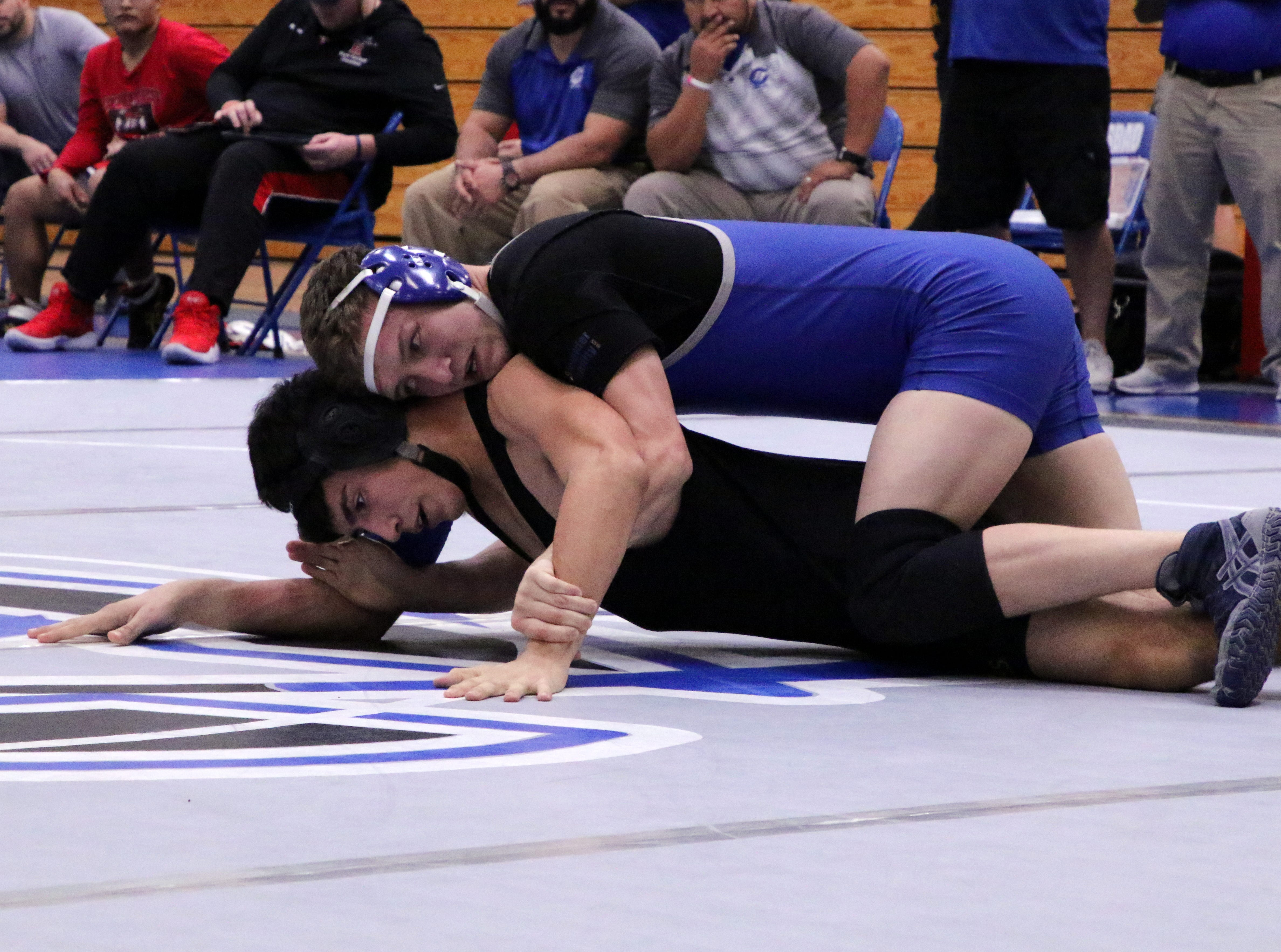 Justin Wood gains top position on Matthew Felicetti from Hobbs in the 160-pound division.