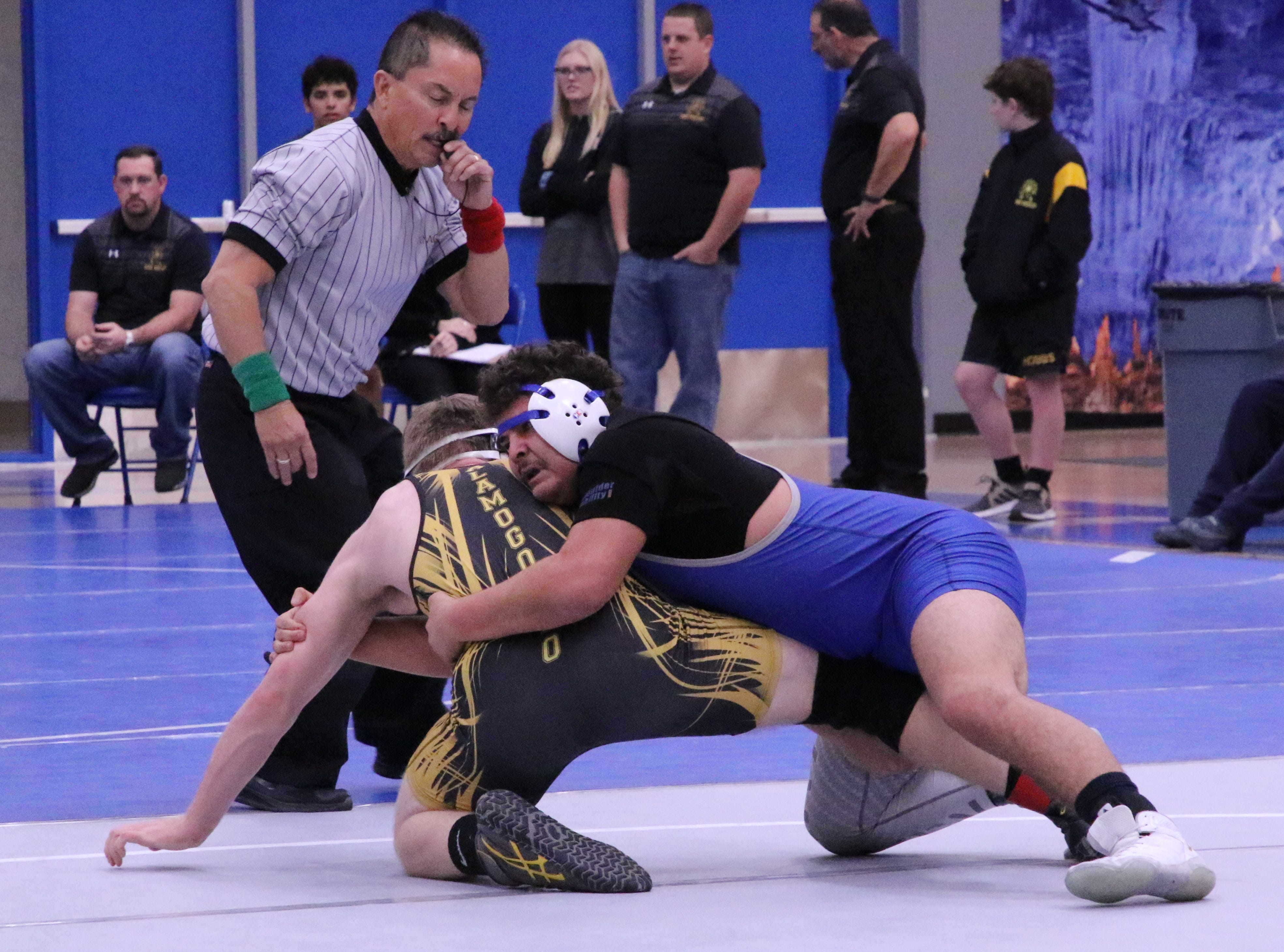 RJ Baca holds on to Alamogordo's Max Merrell in the 182-pound division.
