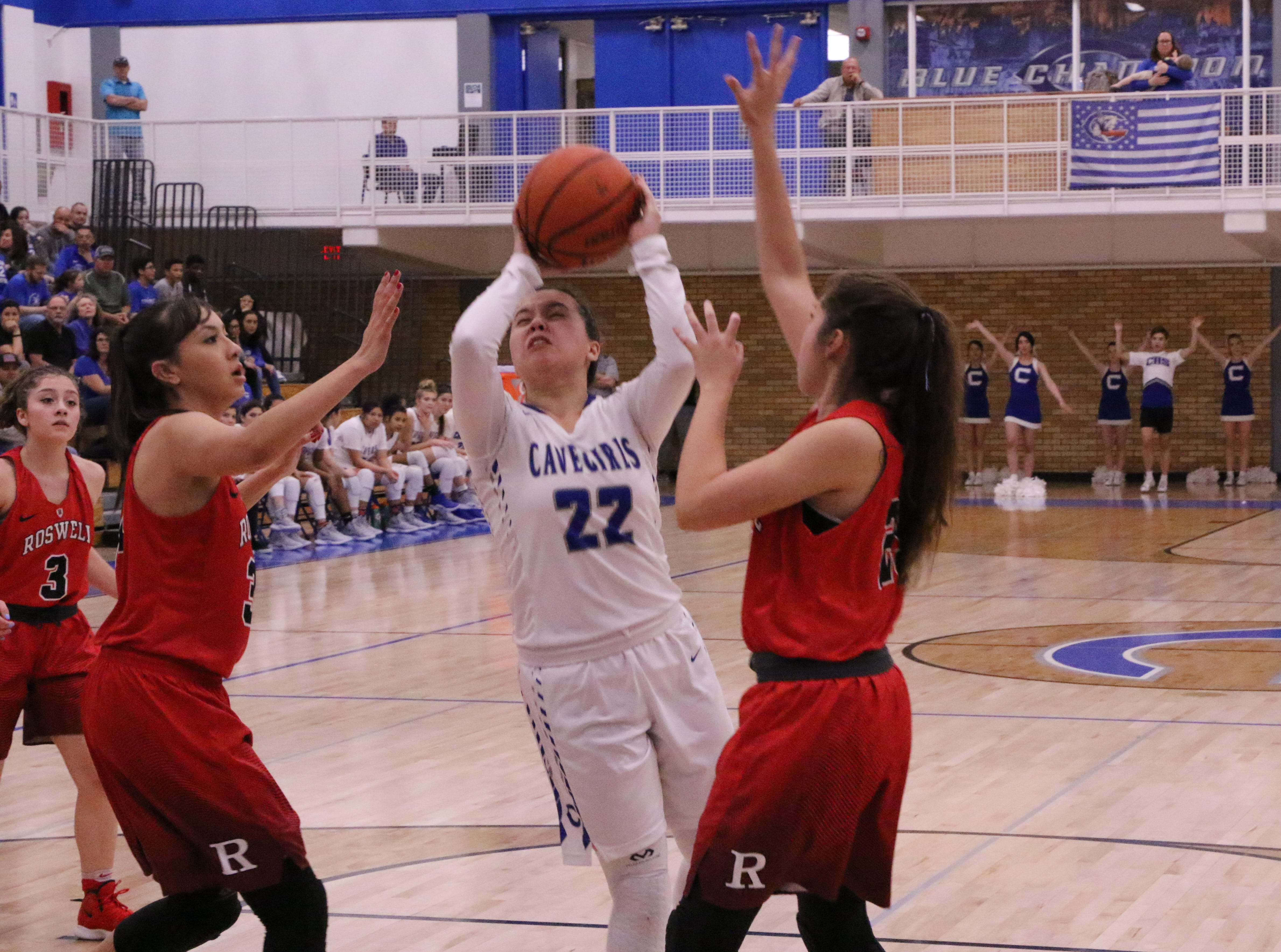 Nyah Chacon (22) goes for a shot during the first half of Friday's game.