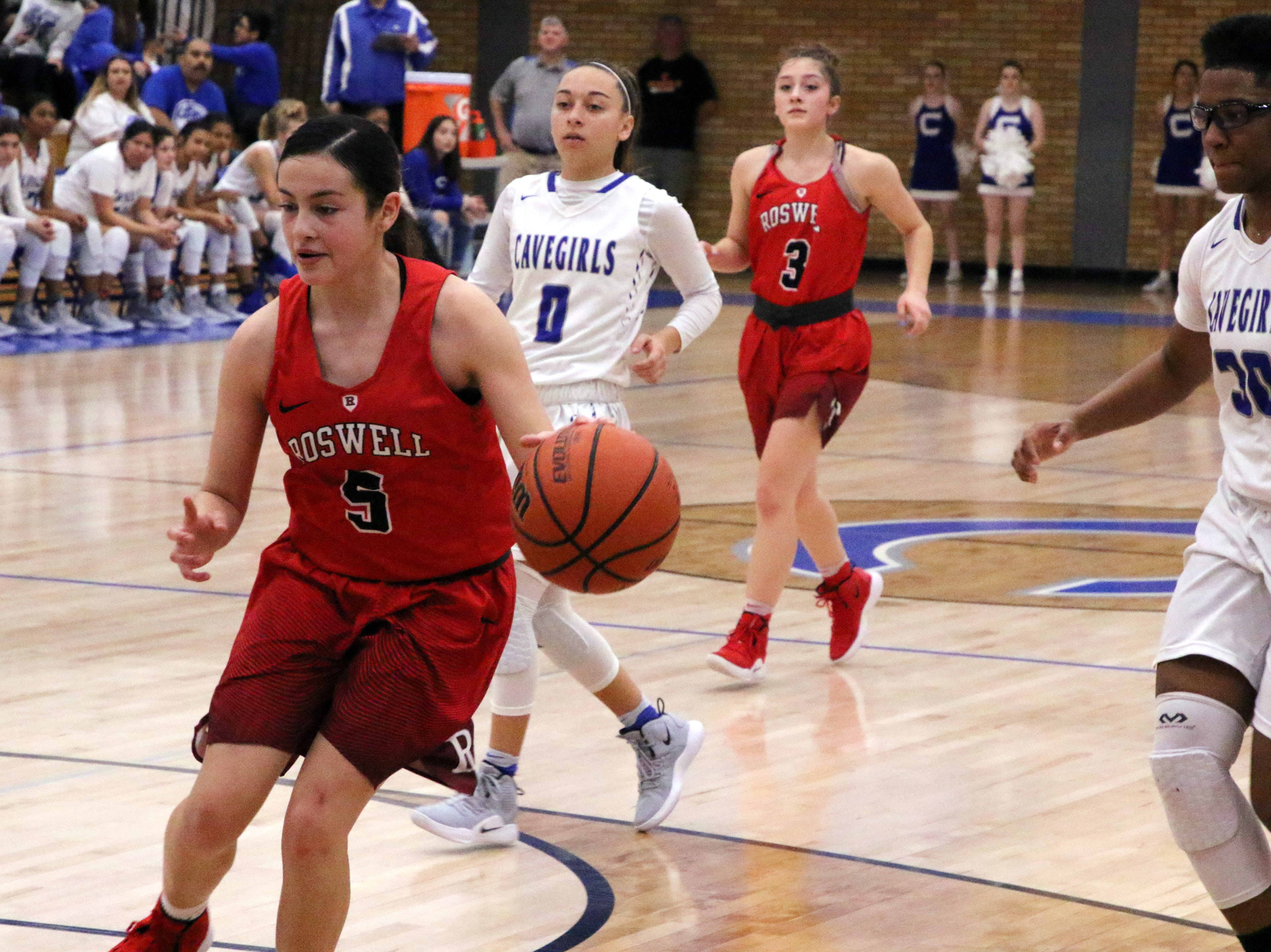 Roswell's Mercedes Velasco drives the lane in the third quarter of Friday's game against Carlsbad.