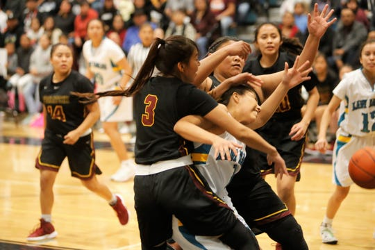 Navajo Prep's Laila Charley gets sandwiched in between Tohatchi's Krystal Benally (3) and Sarah Begay (55) during a District 1-3A game on Tuesday, Feb. 12 at the Eagles Nest in Farmington. Visit daily-times.com to see the latest sports photo galleries and video highlights.