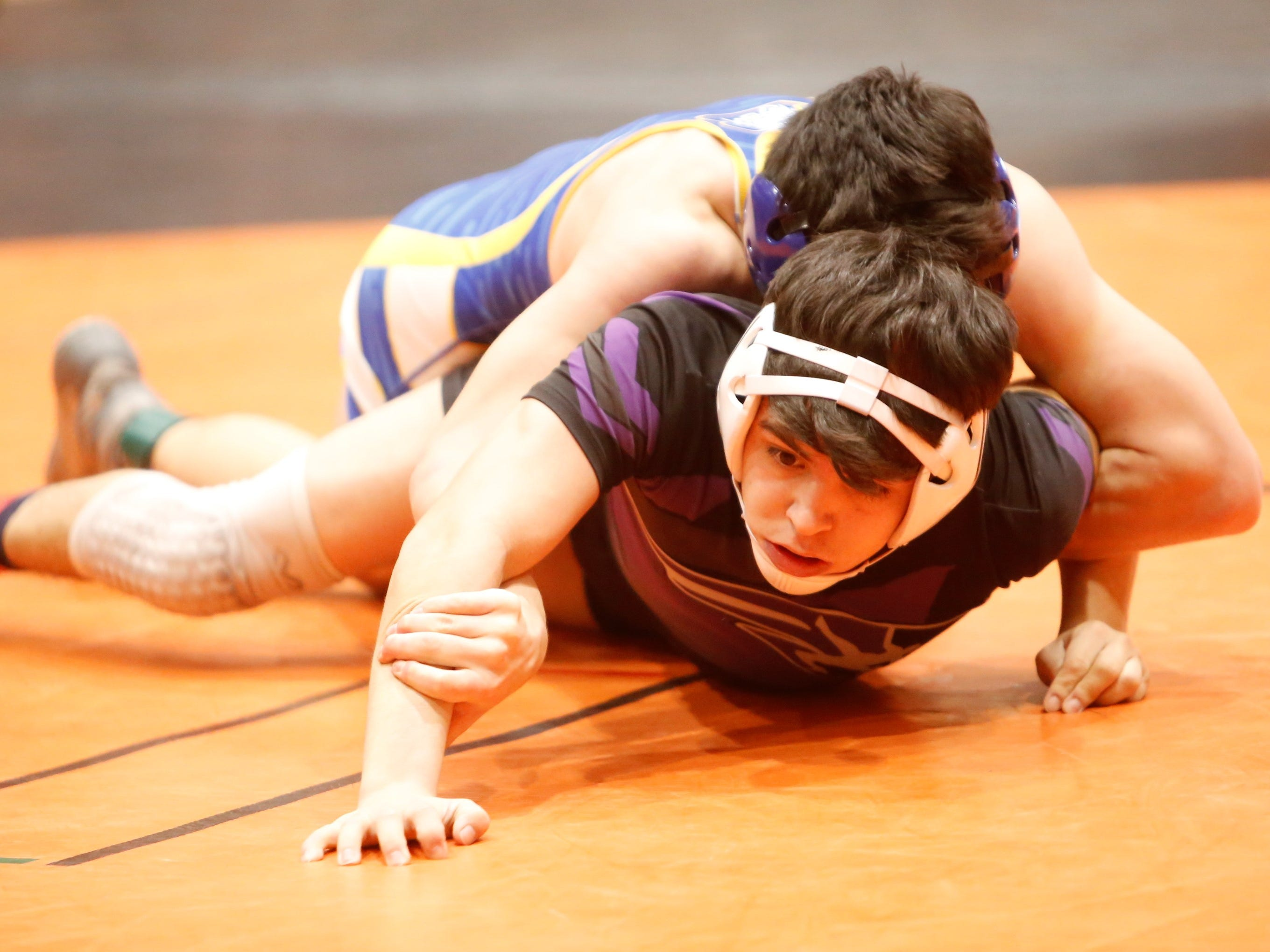 Miyamura's Adam Rodriguez tries to break free from Bloomfield's Ayden Reinhardt in a 126-pound division match during the District 1-4A wrestling championships at Lillywhite Gym in Aztec. Rodriguez took third place in his division, while Reinhardt took second place.