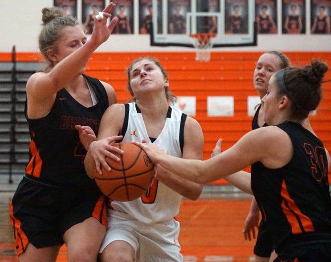 Mustang Lauren Marshall runs into a lot of Bulldogs near the basket.