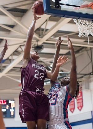 Isaiah Gaines (23) shoots over Taajhir McCall (23) during the Pensacola vs. Pine Forest District 1-7A tournament basketball game at Pace High School on Friday, February 15, 2019.