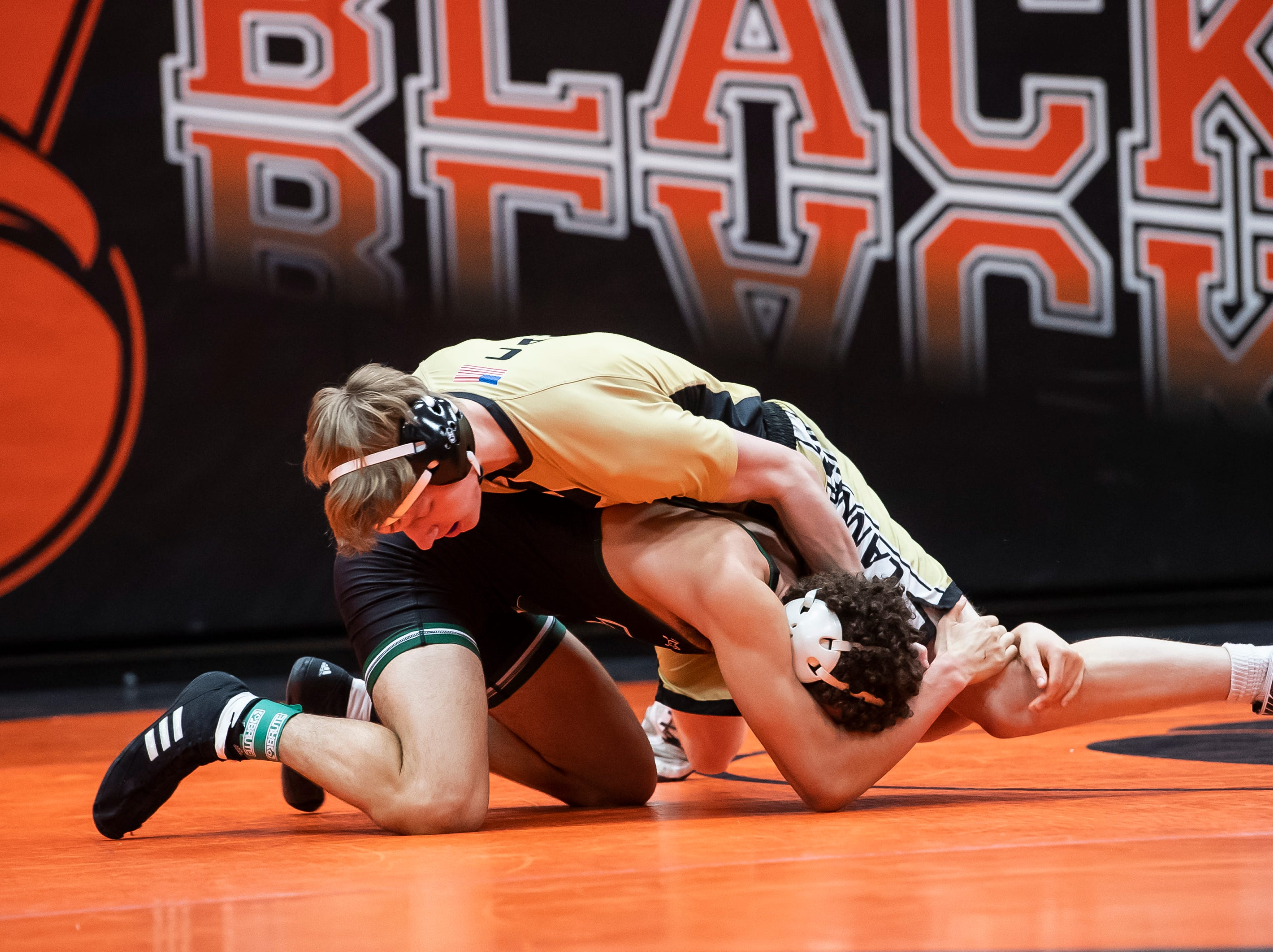 Biglerville's Tristan Metzger, top, wrestles Trinity's Makoa Neibel during a 160-pound bout during the first day of the District 3 Class 2A Section I tournament at Susquenita High School Friday, February 15, 2019. Neibel won by fall.