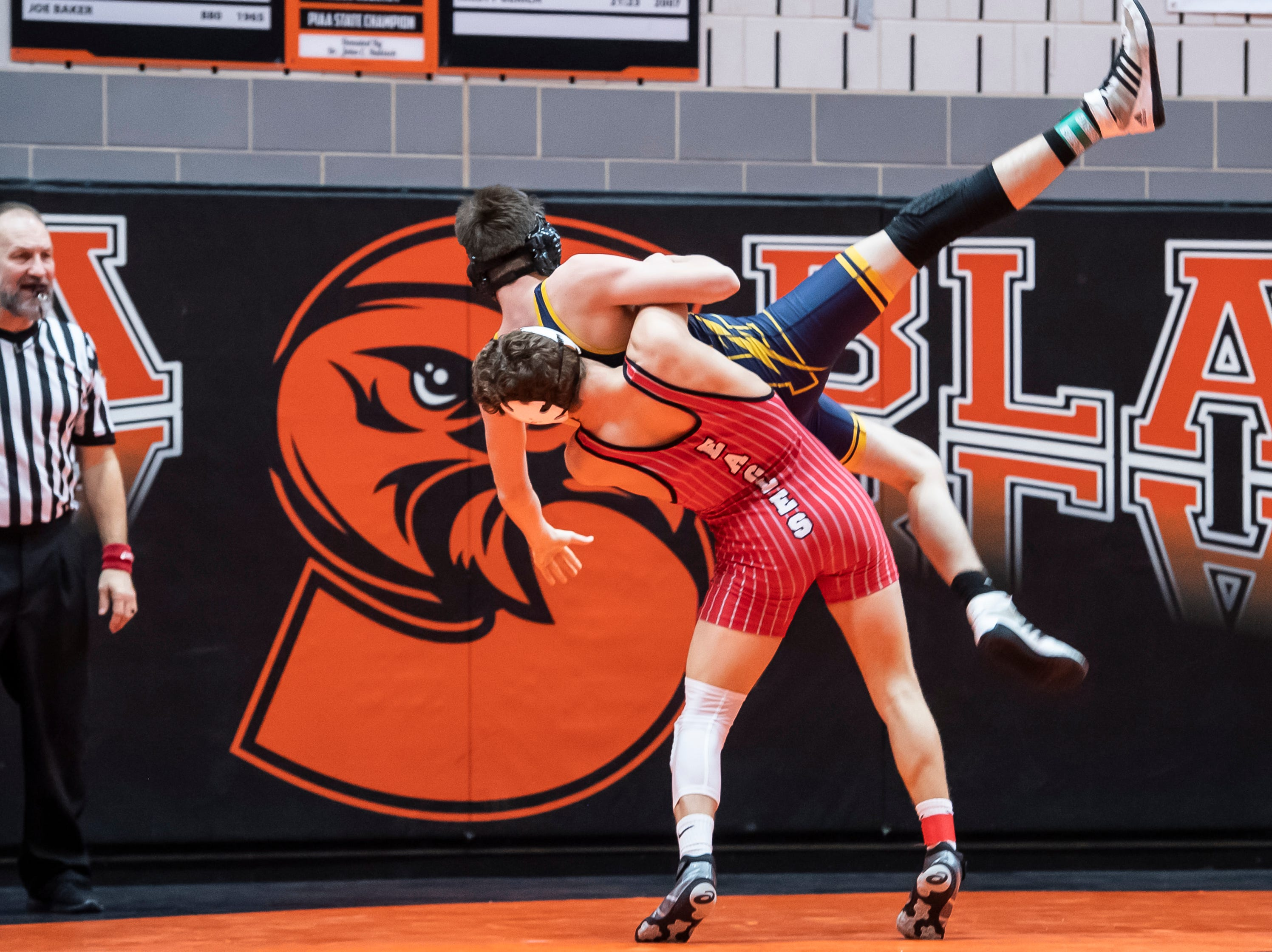 Bermudian Springs' Trenton Harder takes down Littlestown's Ashton Hensley during a 152-pound bout during the first day of the District 3 Class 2A Section I tournament at Susquenita High School Friday, February 15, 2019. Harder won by fall.