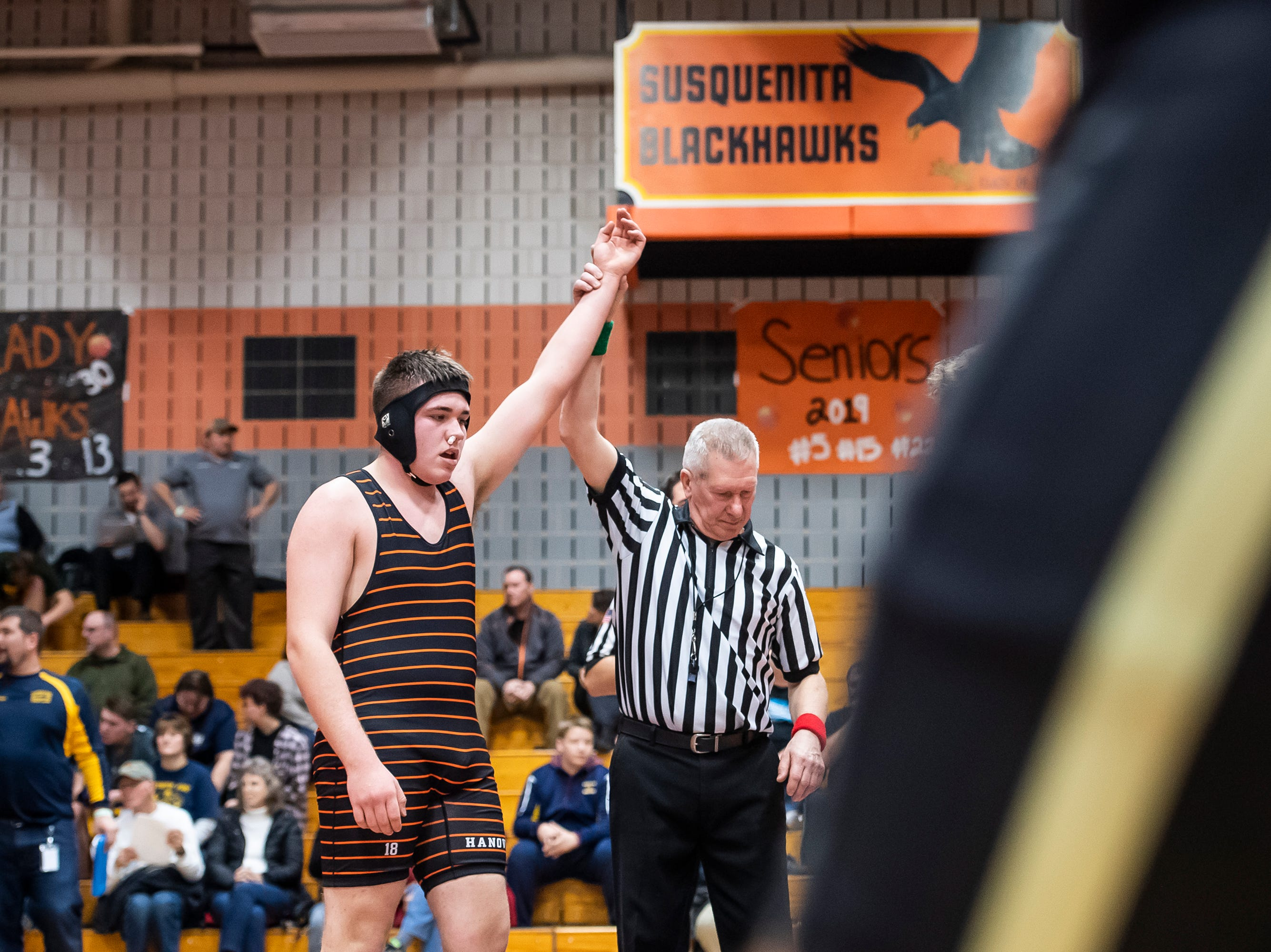 Hanover's Kardan Trish has his arm raised after defeating Bermudian Springs Blaine Worden in a 220-pound bout during the first day of the District 3 Class 2A Section I tournament at Susquenita High School Friday, February 15, 2019. Trish won 3-1.