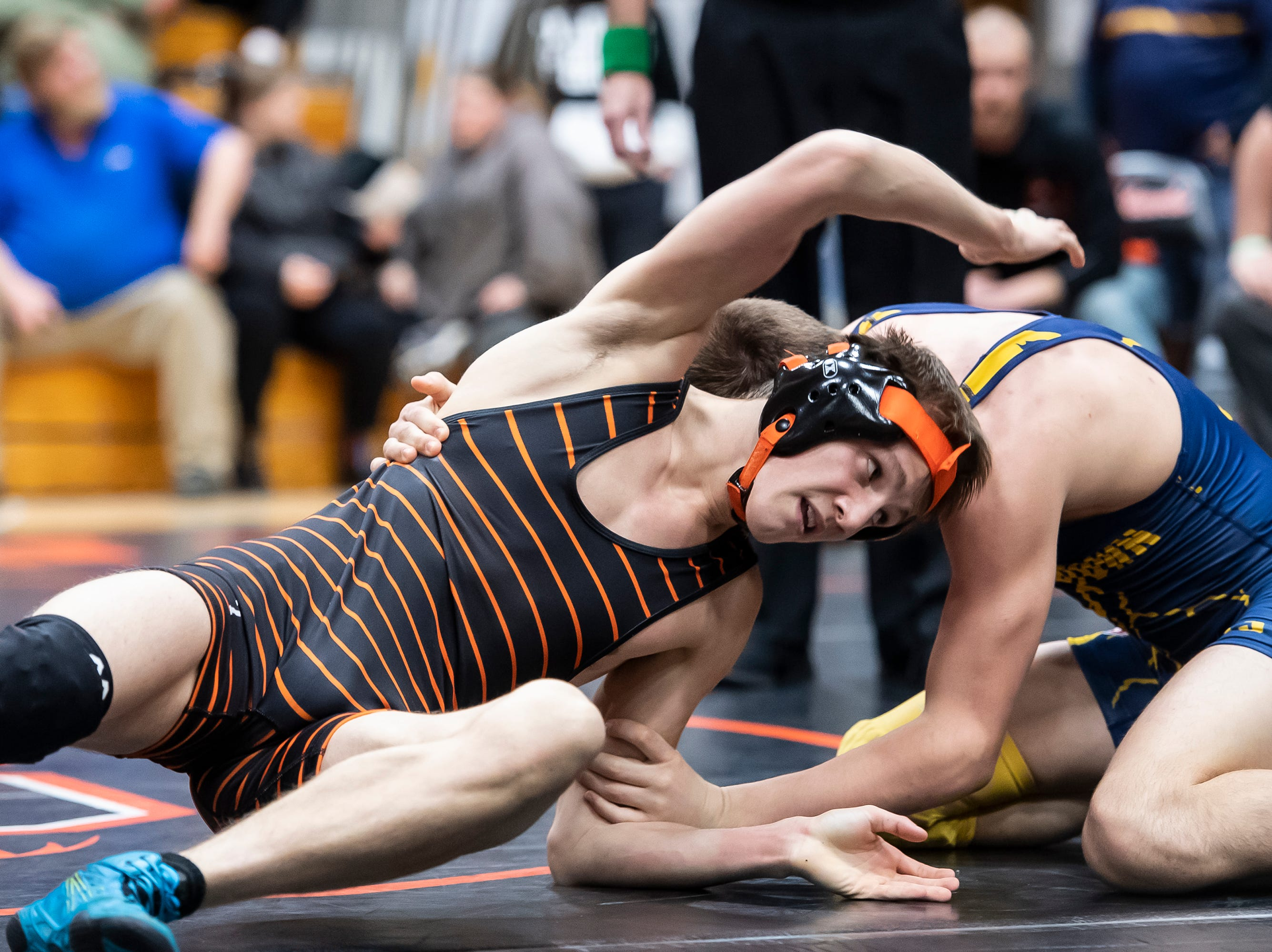 Hanover's Dalton Kirby, left, wrestles Littlestown's Ayden Dillon during a 126-pound bout during the first day of the District 3 Class 2A Section I tournament at Susquenita High School Friday, February 15, 2019. Dillon won by fall.