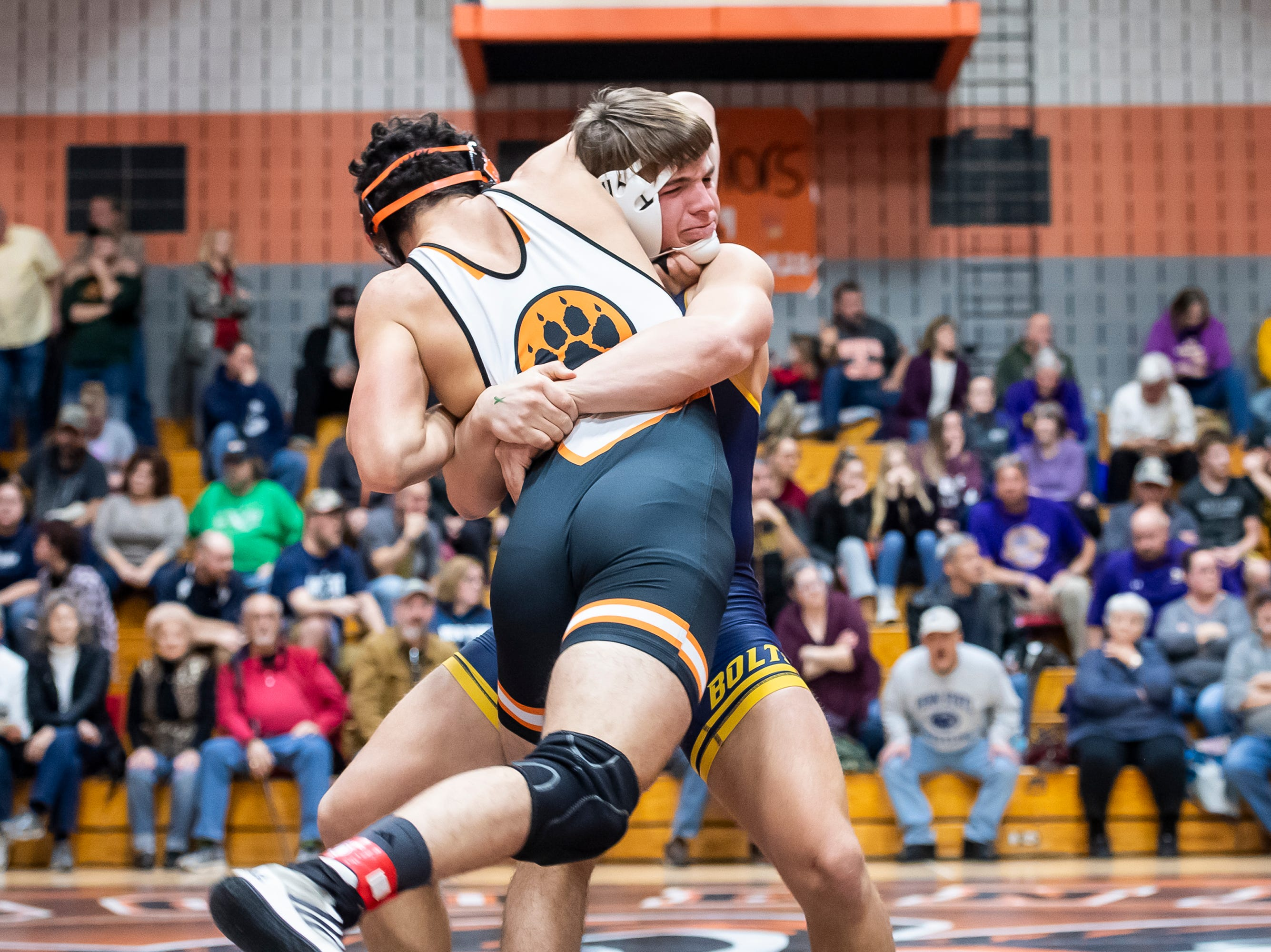 Littlestown's Jacoby Yealy, back, wrestles East Pennsboro's Abdelrahman Khalafalla in a 145-pound bout on the first day of the District 3 Class 2A Section I tournament at Susquenita High School Friday, February 15, 2019. Yealy won by fall.