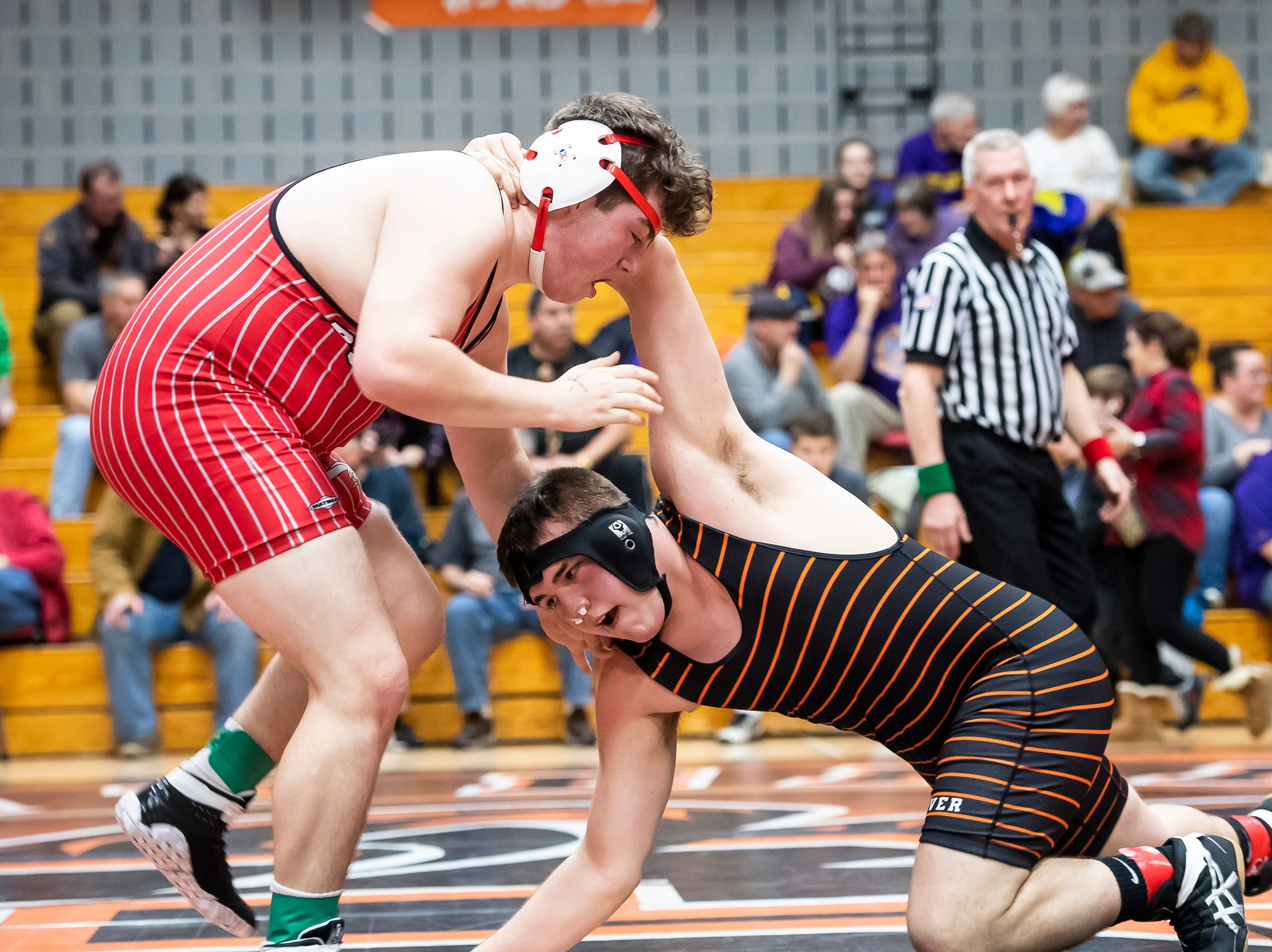 Hanover's Kardan Trish, right, wrestles Bermudian Springs Blaine Worden in a 220-pound bout during the first day of the District 3 Class 2A Section I tournament at Susquenita High School Friday, February 15, 2019. Trish won 3-1.