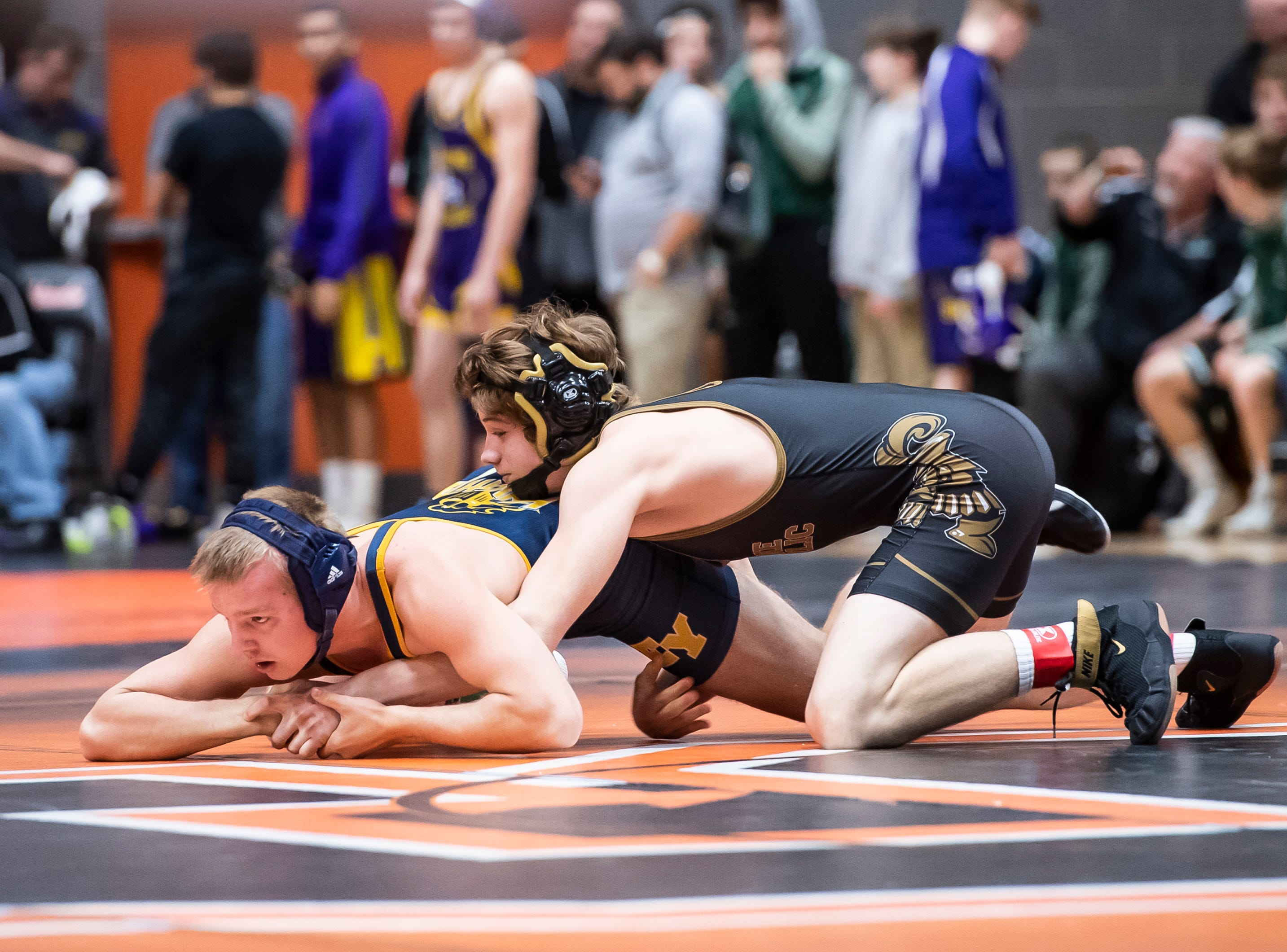 Delone Catholic's Tate Neiderer, tops, wrestles Eastern York's Jonah Dougherty during a 145-pound bout during the first day of the District 3 Class 2A Section I tournament at Susquenita High School Friday, February 15, 2019. Neiderer won by major decision, 9-1.