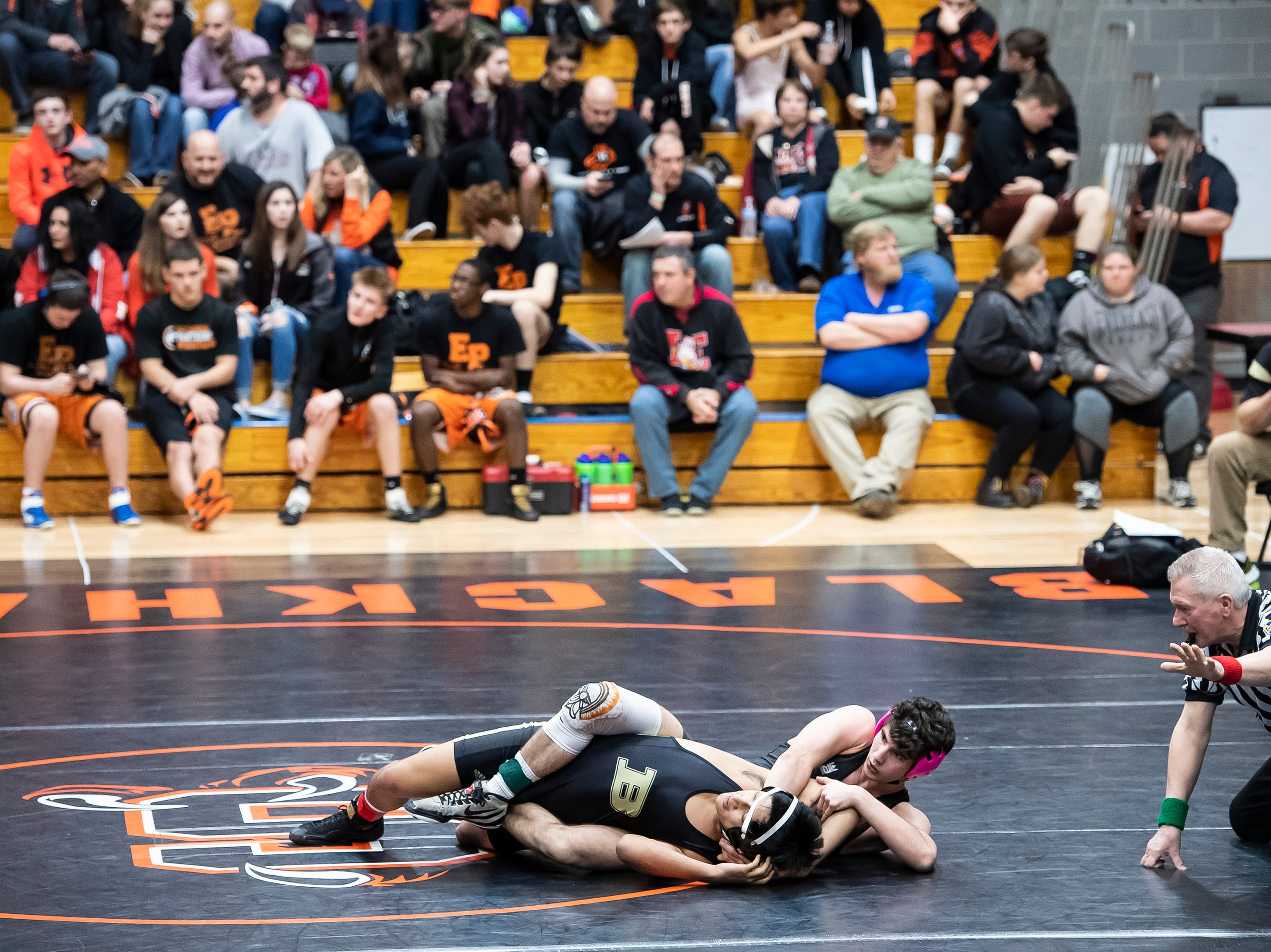 Biglerville's Isaac Sierra-Soto, bottom, wrestles Upper Dauphin's Tyler Wright during a 145-pound bout during the first day of the District 3 Class 2A Section I tournament at Susquenita High School Friday, February 15, 2019. Wright won by tech fall, 17-2.