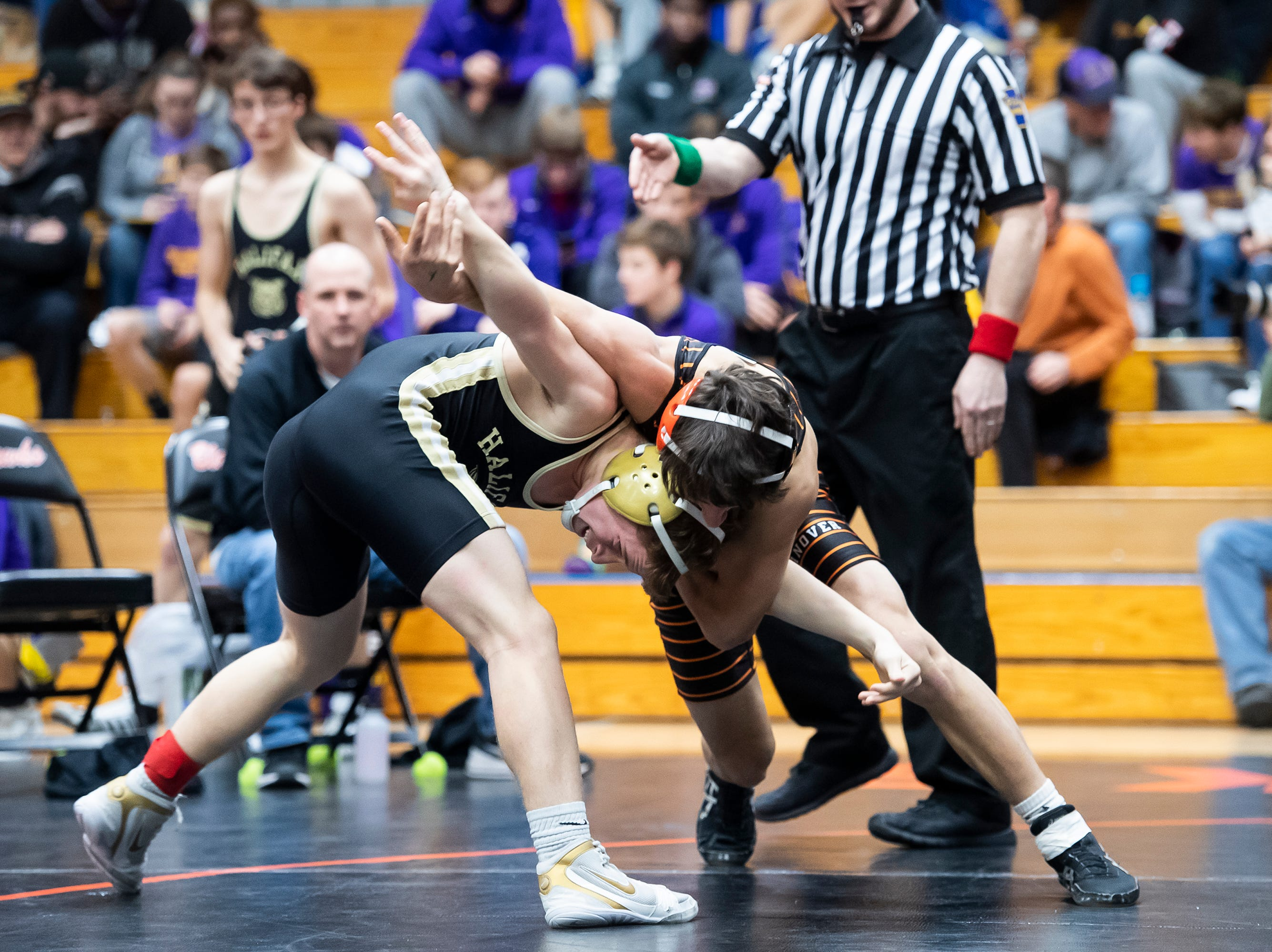 Hanover's Dominic Taylor, right, wrestles Halifax's Austin Mundorf in a 113-pound bout during the first day of the District 3 Class 2A Section I tournament at Susquenita High School Friday, February 15, 2019. Taylor won by fall.