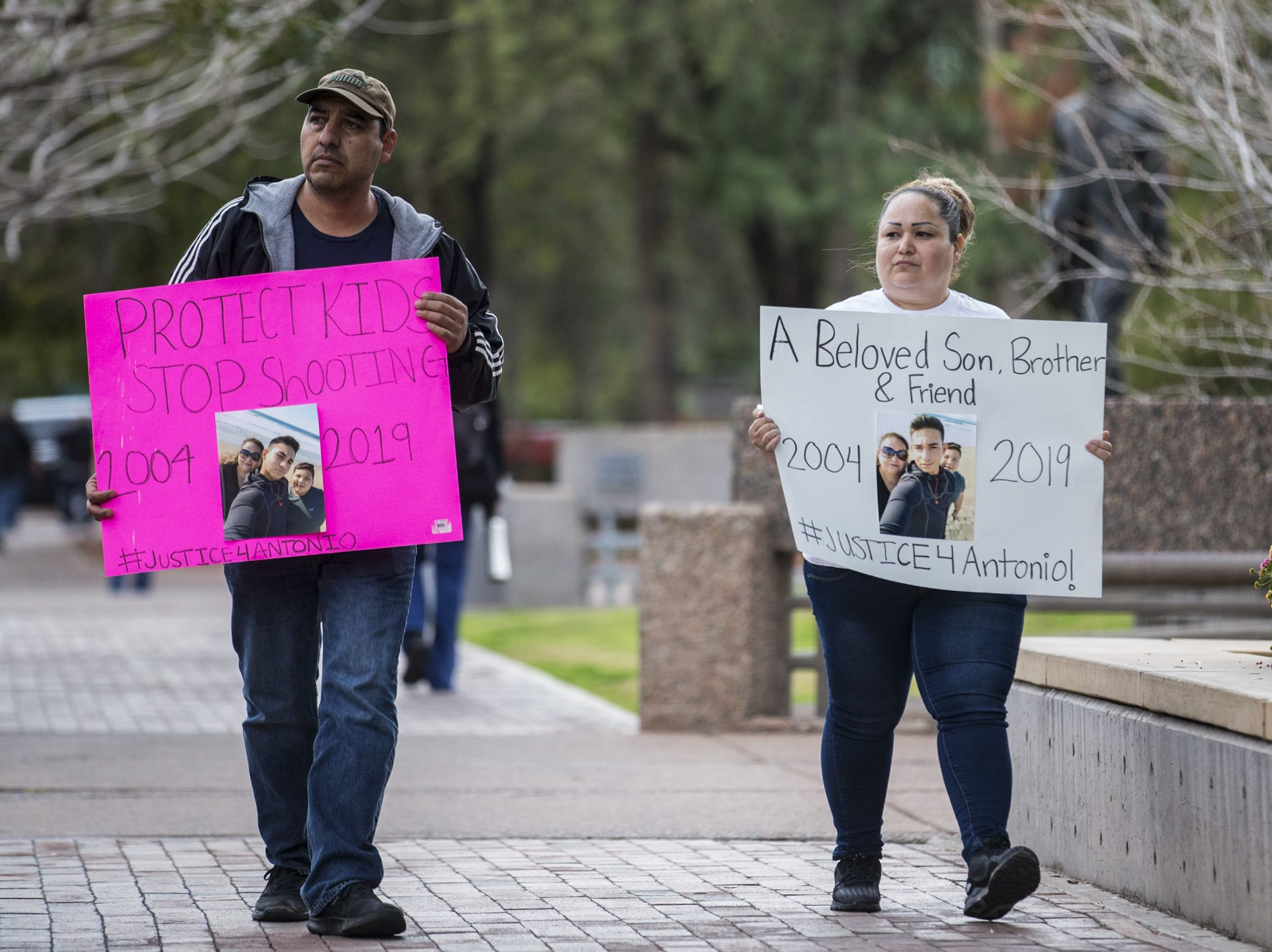 Juan Antonio Arce and Sandra Gonzalez, parents of Antonio Arce, arrive for a rally on the one-month anniversary of the police shooting of the 14-year-old on Friday, Feb. 15, 2019, outside Tempe Police headquarters in Tempe, Ariz.