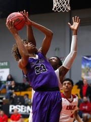 Millennium's DaRon Holmes (23) shoots against  Ironwood's Malik Smith (1) during the first half of the 5A state quarterfinal game at Ironwood High School in Glendale, Ariz. on February 15, 2019.