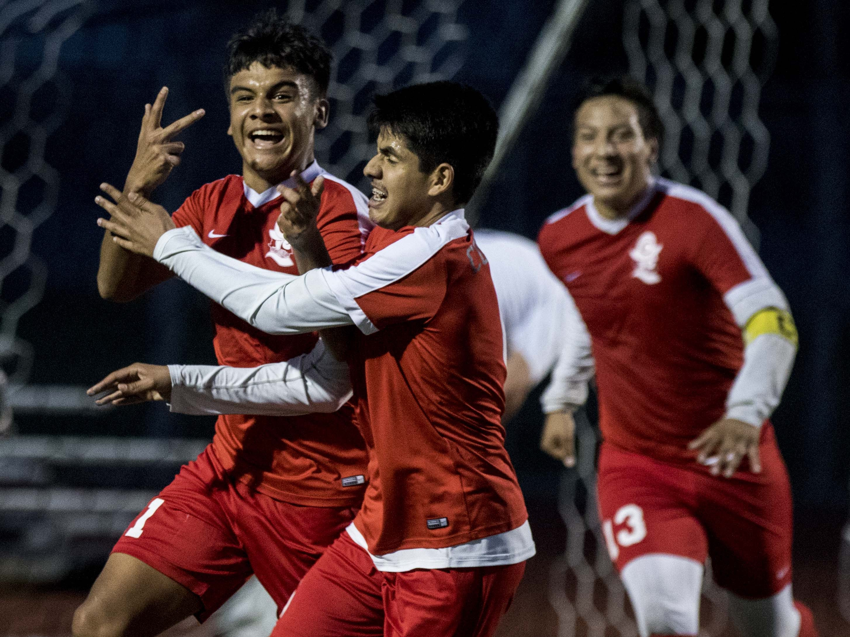 Coronado's Carlos Mendoza (11) celebrates his goal with Yohan Palafox (6) during their game with Northwest Christian's during the 3A State Championship game in Chandler, Friday, Feb .15,  2019.