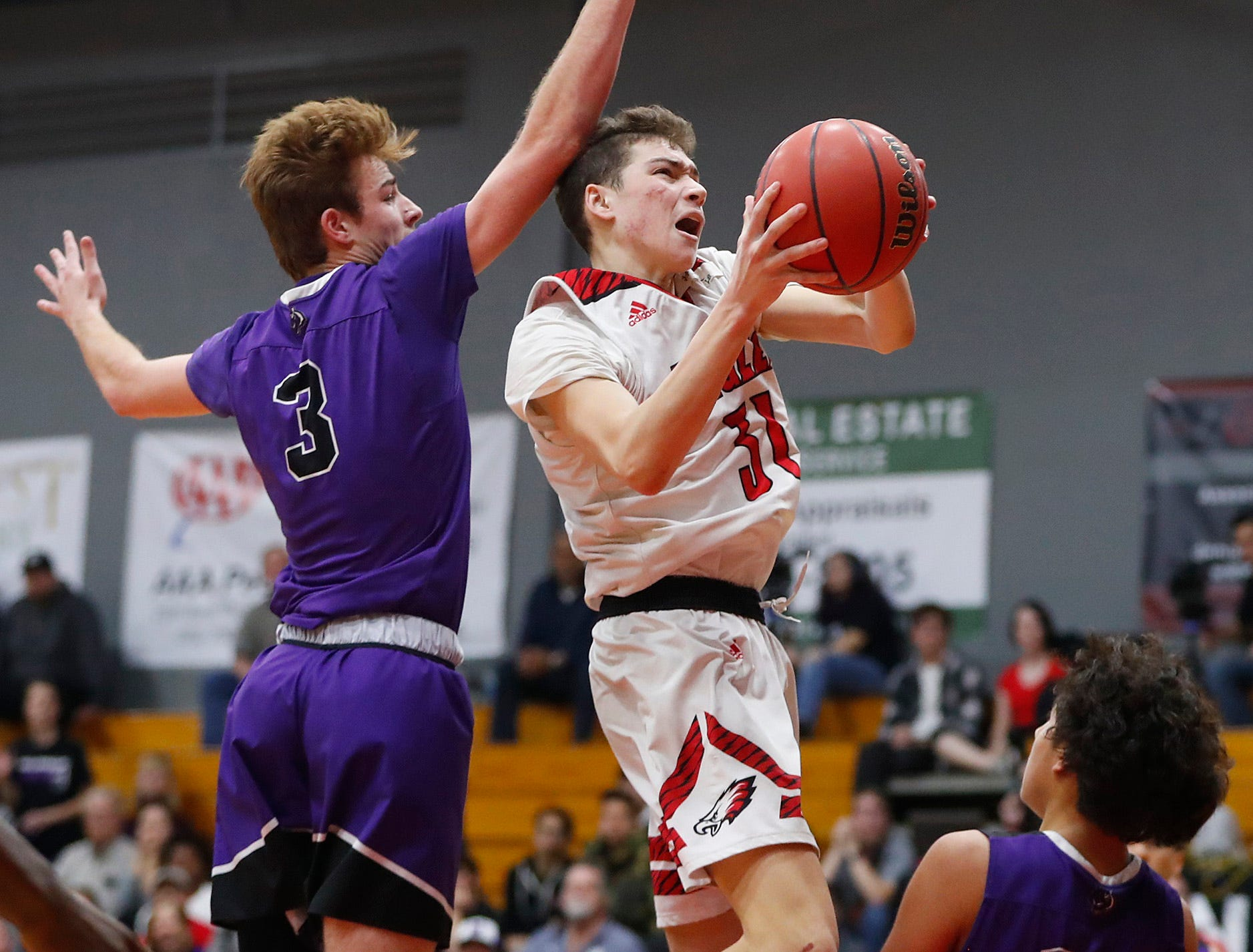 Ironwood's Cassius Carmichael (31) shoots against Millennium's Michael Batchelor (3) during the first half of the 5A state quarterfinal game at Ironwood High School in Glendale, Ariz. on February 15, 2019.