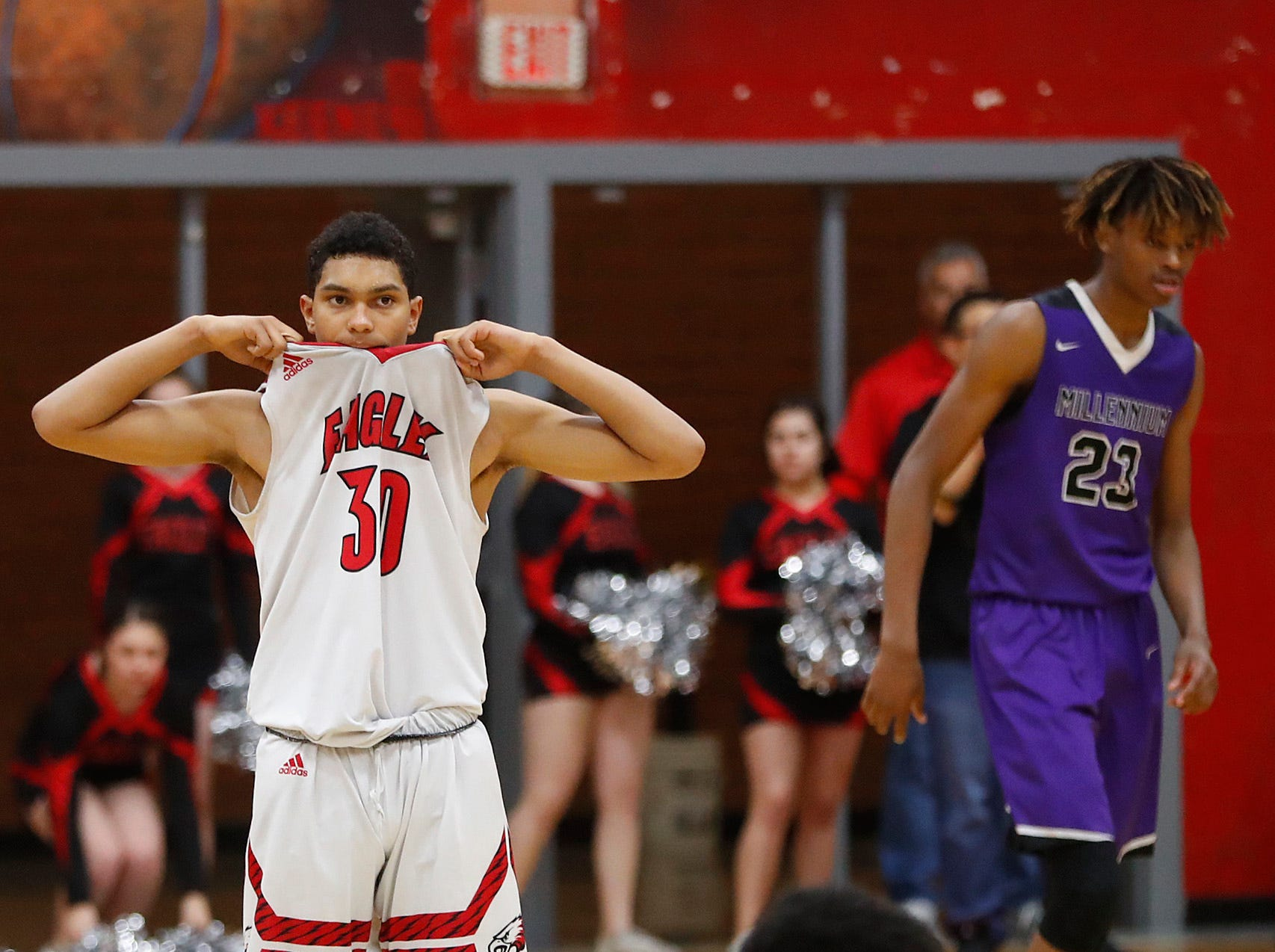 Ironwood's JJ White (30) and Malik Smith (1) pull the jersey up after realizing a call for a lane violation during the second half of the 5A state quarterfinal game against Millennium at Ironwood High School in Glendale, Ariz. on February 15, 2019.