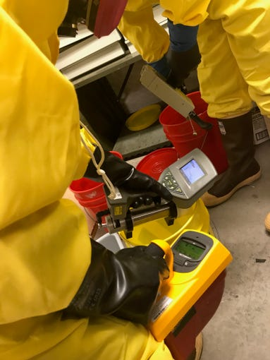 OSHA sent inspectors to the Grand Canyon's museum building, where uranium sites were traced to three buckets inside. An investigation is underway.