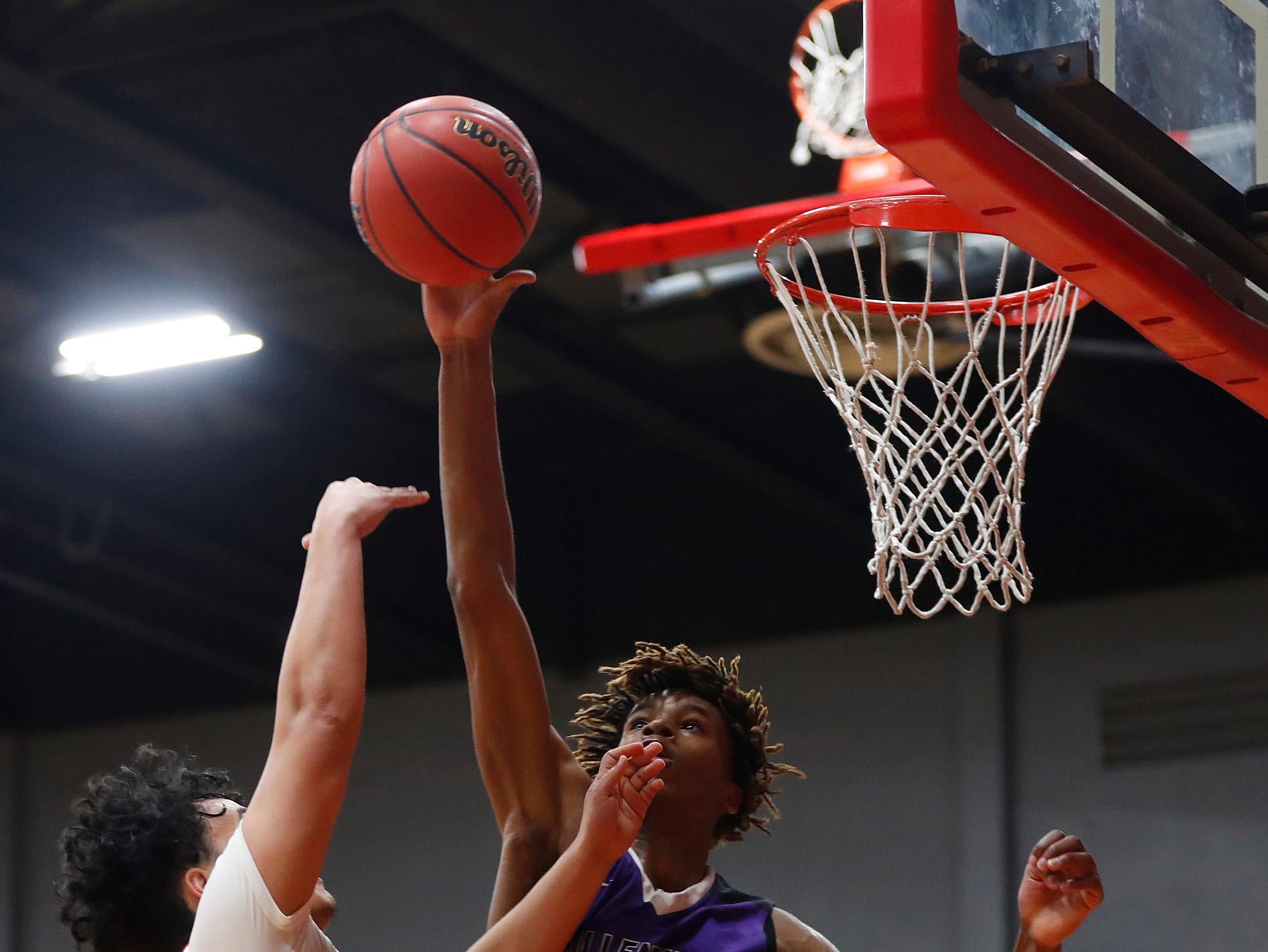 Millennium's DaRon Holmes (23) blocks a shot Ironwood's Jordan Kafoa (12) during the second half of the 5A state quarterfinal game at Ironwood High School in Glendale, Ariz. on February 15, 2019.