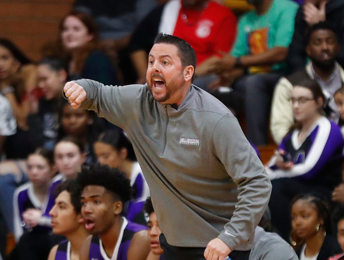 Millennium's head coach Ty Amundsen yells to an official during the first half of the 5A state quarterfinal game against Ironwood at Ironwood High School in Glendale, Ariz. on February 15, 2019.