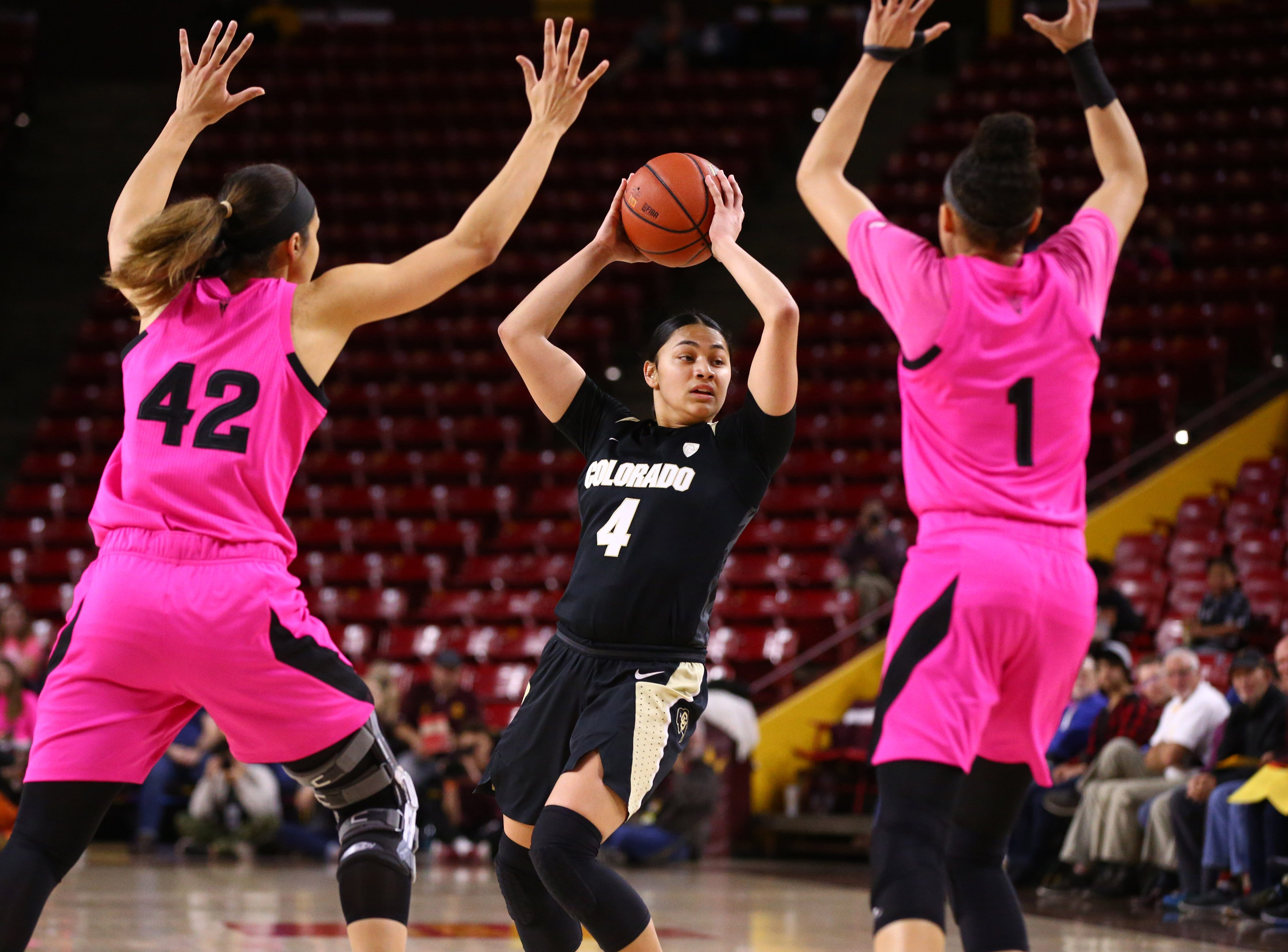Arizona State Sun Devils Kianna Ibis (42) and Taya Hanson (1) pressure Colorado Buffaloes guard Lesila Finau (4) in the first half on Feb. 15 at Wells Fargo Arena in Tempe, Ariz.