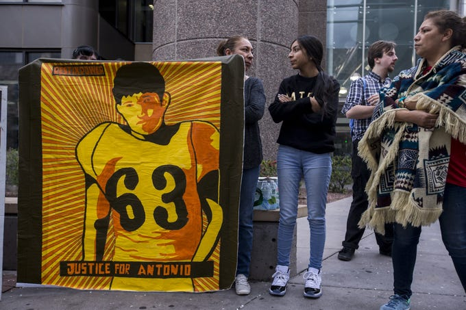 People gather for a rally on the one-month anniversary of the police shooting of 14-year-old Antonio Arce on Friday, Feb. 15, 2019, outside Tempe Police headquarters in Tempe, Ariz.