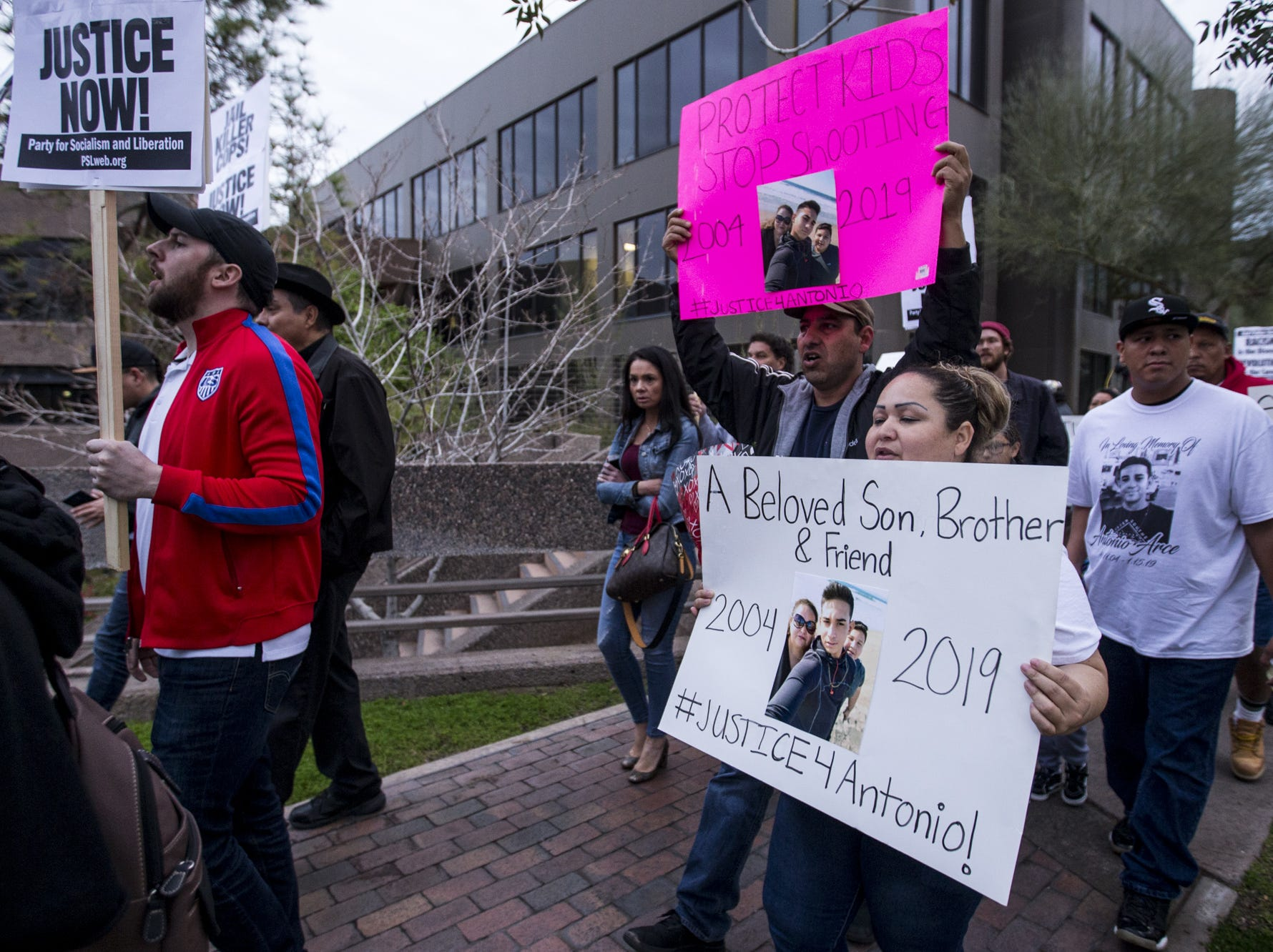 People march during a rally on the one-month anniversary of the police shooting of 14-year-old Antonio Arce on Friday, Feb. 15, 2019, in Tempe, Ariz.