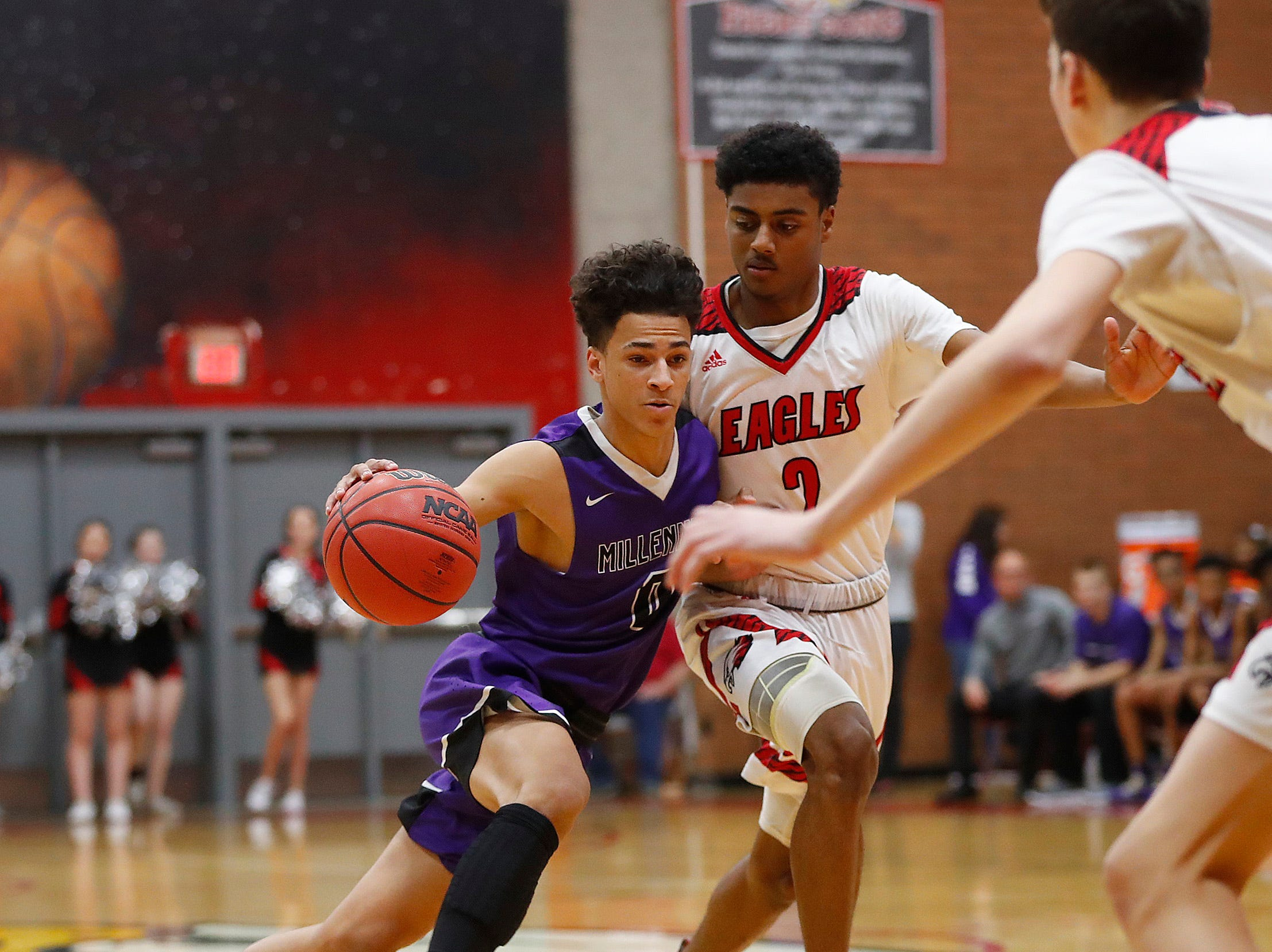 Millennium's Justus Jackson (0) drives on Ironwood's Dominic Gonzalez (2) during the first half of the 5A state quarterfinal game at Ironwood High School in Glendale, Ariz. on February 15, 2019.