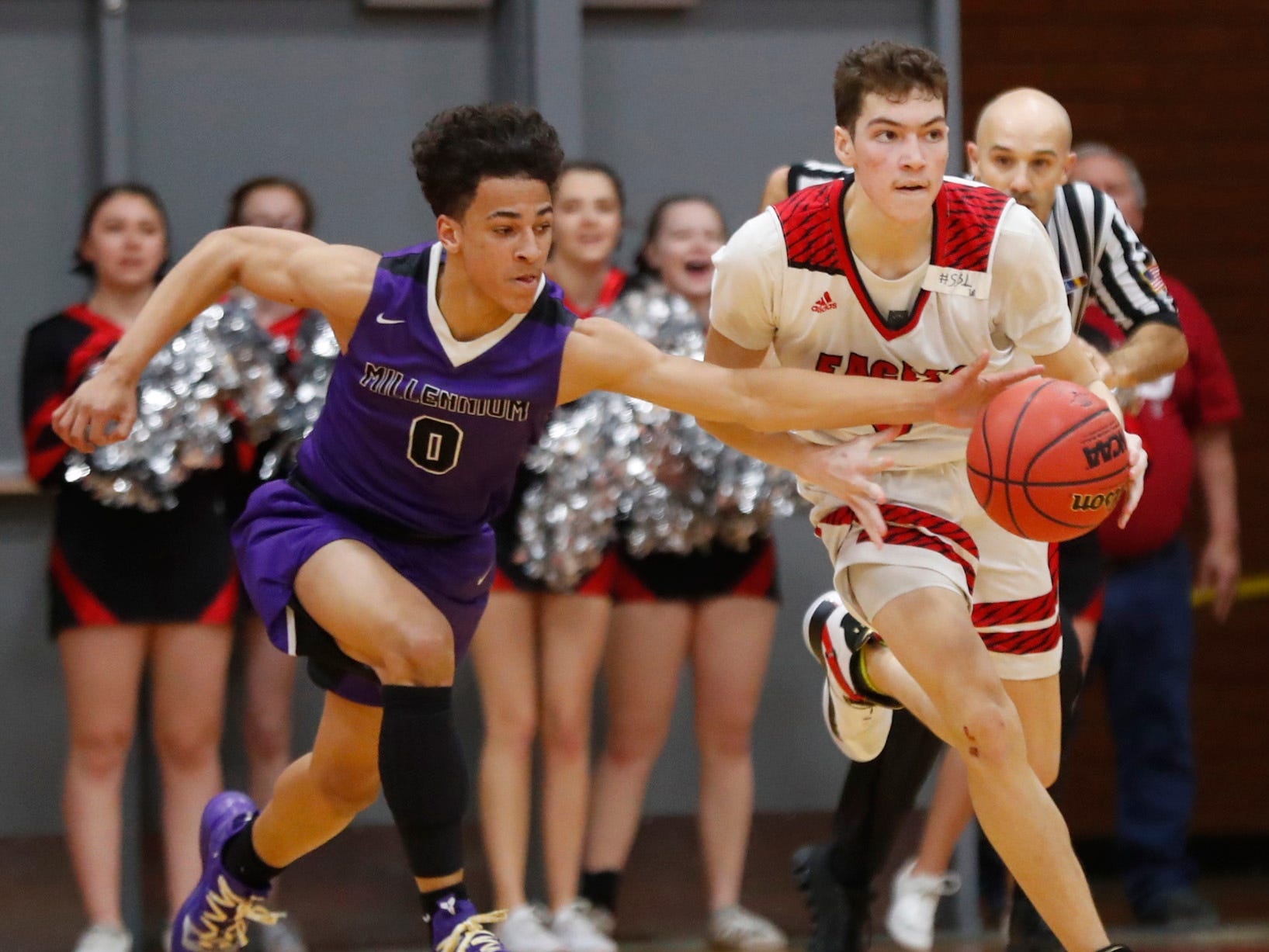 Ironwood's Cassius Carmichael (31) dribbles under pressure from Millennium's Justus Jackson (0) during the first half of the 5A state quarterfinal game at Ironwood High School in Glendale, Ariz. on February 15, 2019.