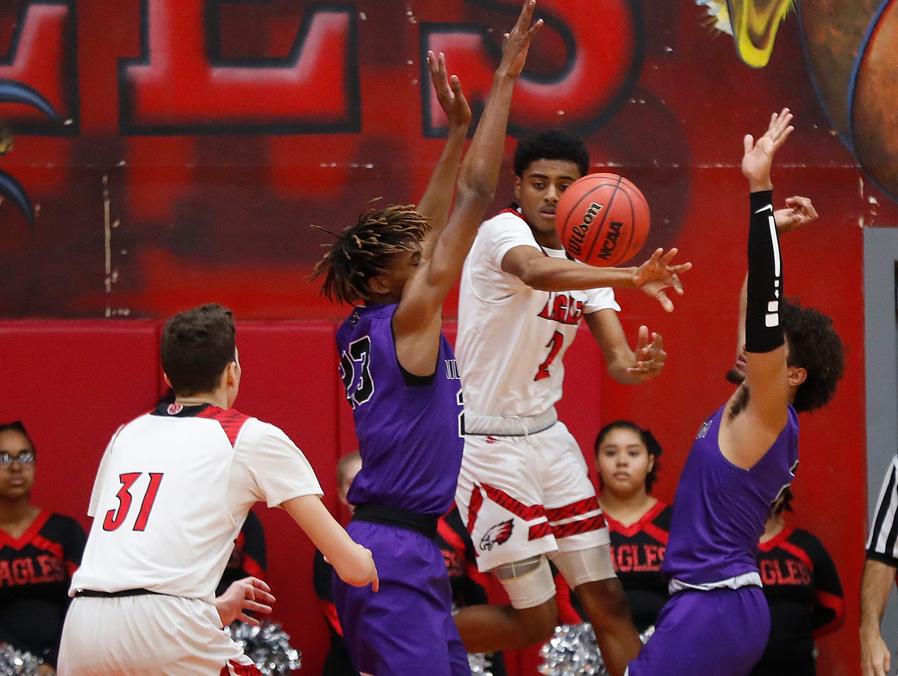 Ironwood's Dominic Gonzalez (2) passes out against Millennium's DaRon Holmes (23) during the first half of the 5A state quarterfinal game at Ironwood High School in Glendale, Ariz. on February 15, 2019.