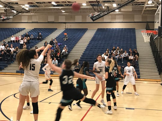 Feb. 15, 2019; Phoenix Pinnacle sophomore guard Shay Figueroa hits one of her five 3-pointers in the 6A quarterfinal against Gilbert Highland.
