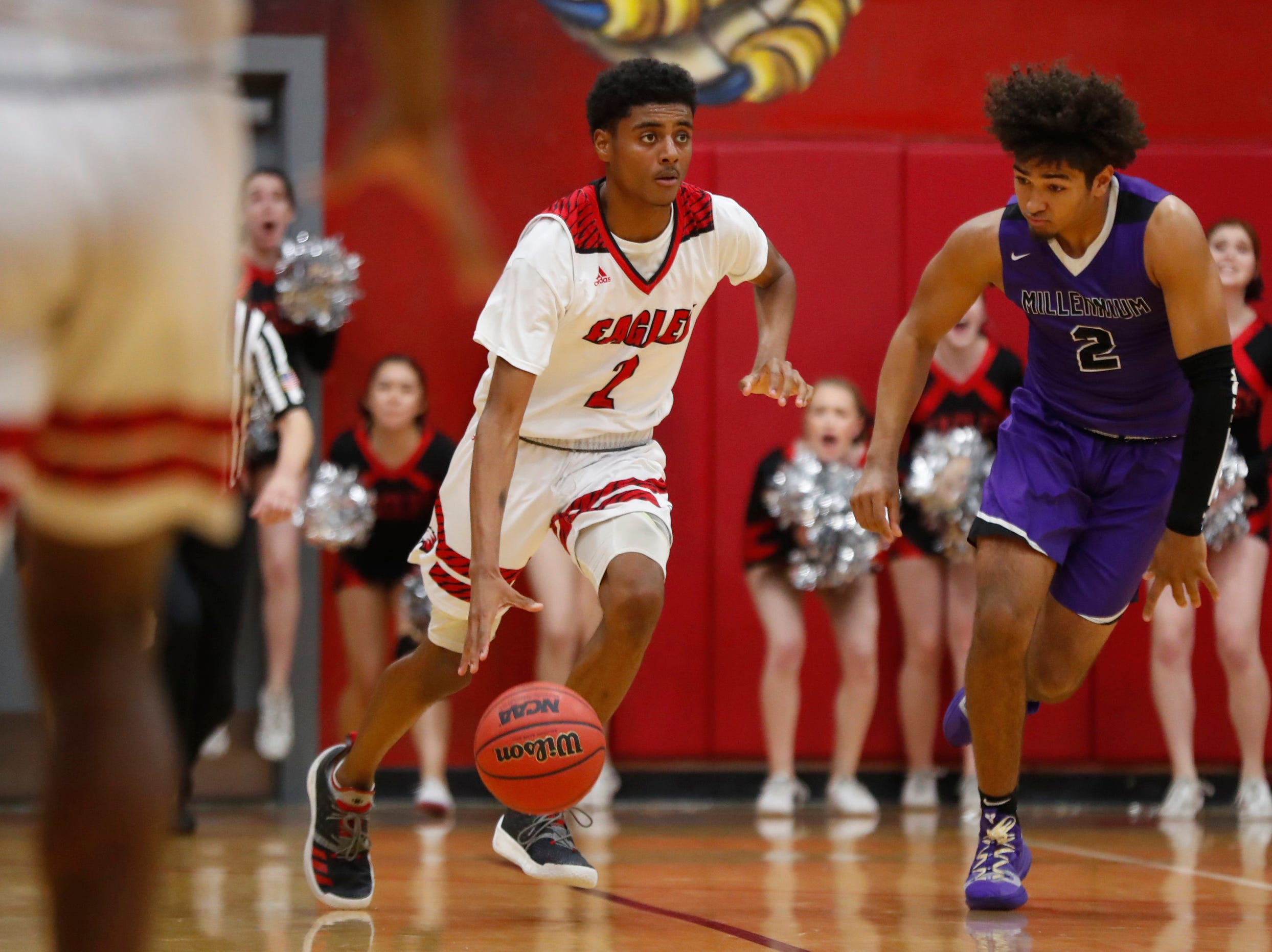 Ironwood's Dominic Gonzalez (2) dribbles against Millennium's Jalan Early (2) during the second half of the 5A state quarterfinal game against Millennium at Ironwood High School in Glendale, Ariz. on February 15, 2019.