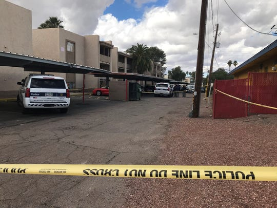 Police set up a crime scene outside a Phoenix apartment near 35th Avenue and Dunlap Road where a 3-year-old boy was shot the morning of Feb. 16, 2019.