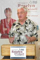 Leo Corbet speaks at a press conference at the Duley Jones Gallery in downtown Scottsdale, endorsing Roselyn O'Connell for U.S. Congress on July 20, 2004.