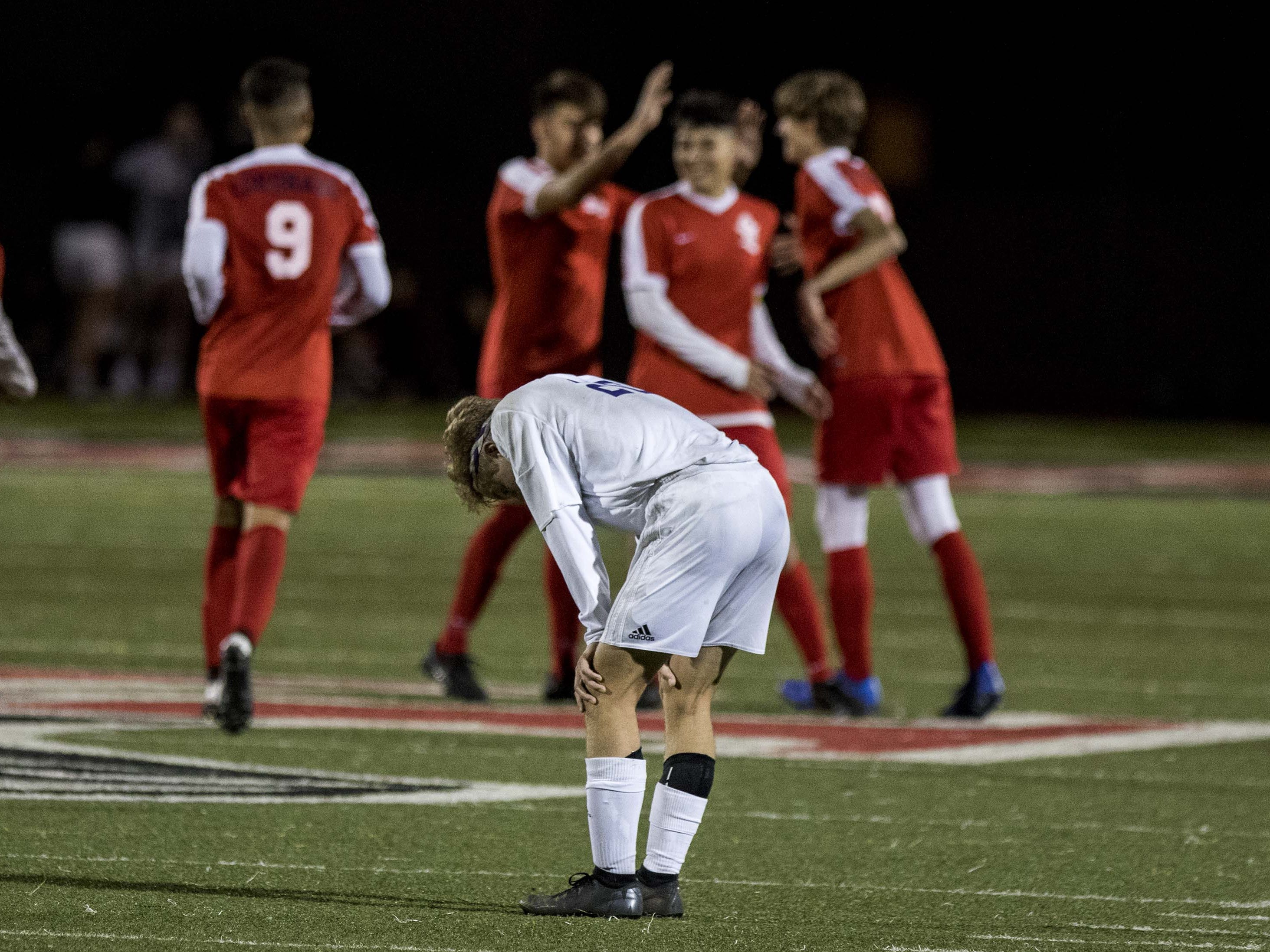 Coronado's players celebrate their fifth goal as Northwest Christian's Grant Gibson (20) appears to be dejected during the 3A State Championship game in Chandler, Friday, Feb .15,  2019.