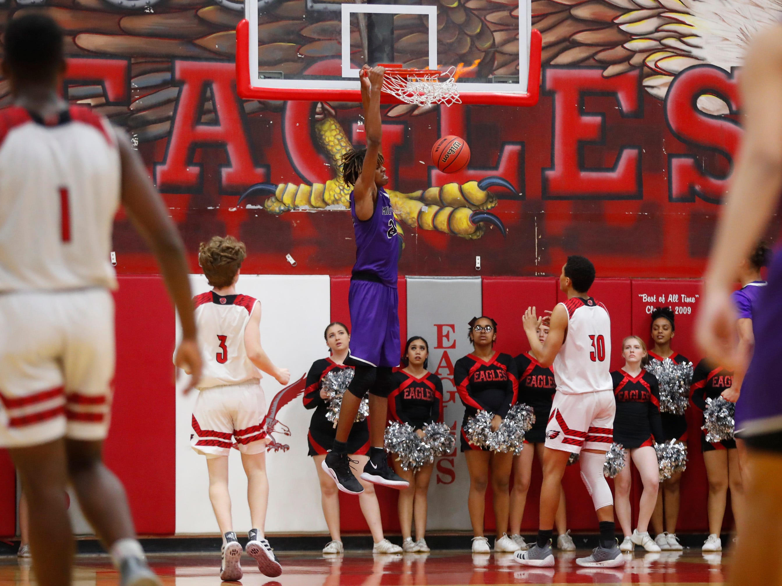 Millennium's DaRon Holmes (23) dunks against Ironwood during the first half of the 5A state quarterfinal game at Ironwood High School in Glendale, Ariz. on February 15, 2019.