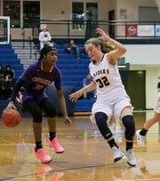 Elco's Amanda Smith defends against Lancaster Catholic star Kiki Jefferson.