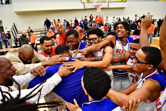 York High celebrates a 54-50 win over New Oxford during York-Adams League boys' basketball championship game action in Grumbacher Sport and Fitness Center at York College in Spring Garden Township, Friday, Feb. 15, 2019. Dawn J. Sagert photo